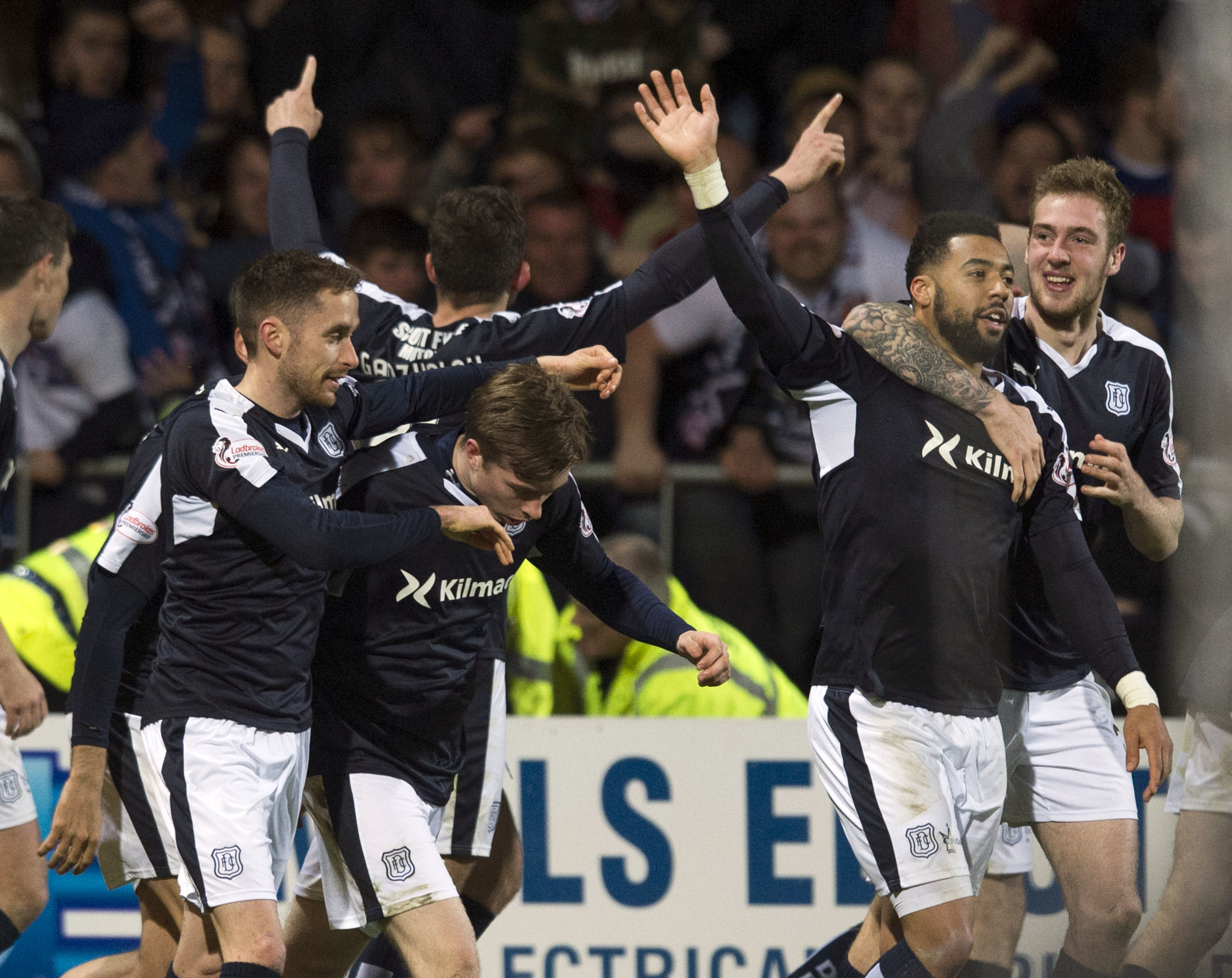 Craig Wighton is hailed after scoring the winner.