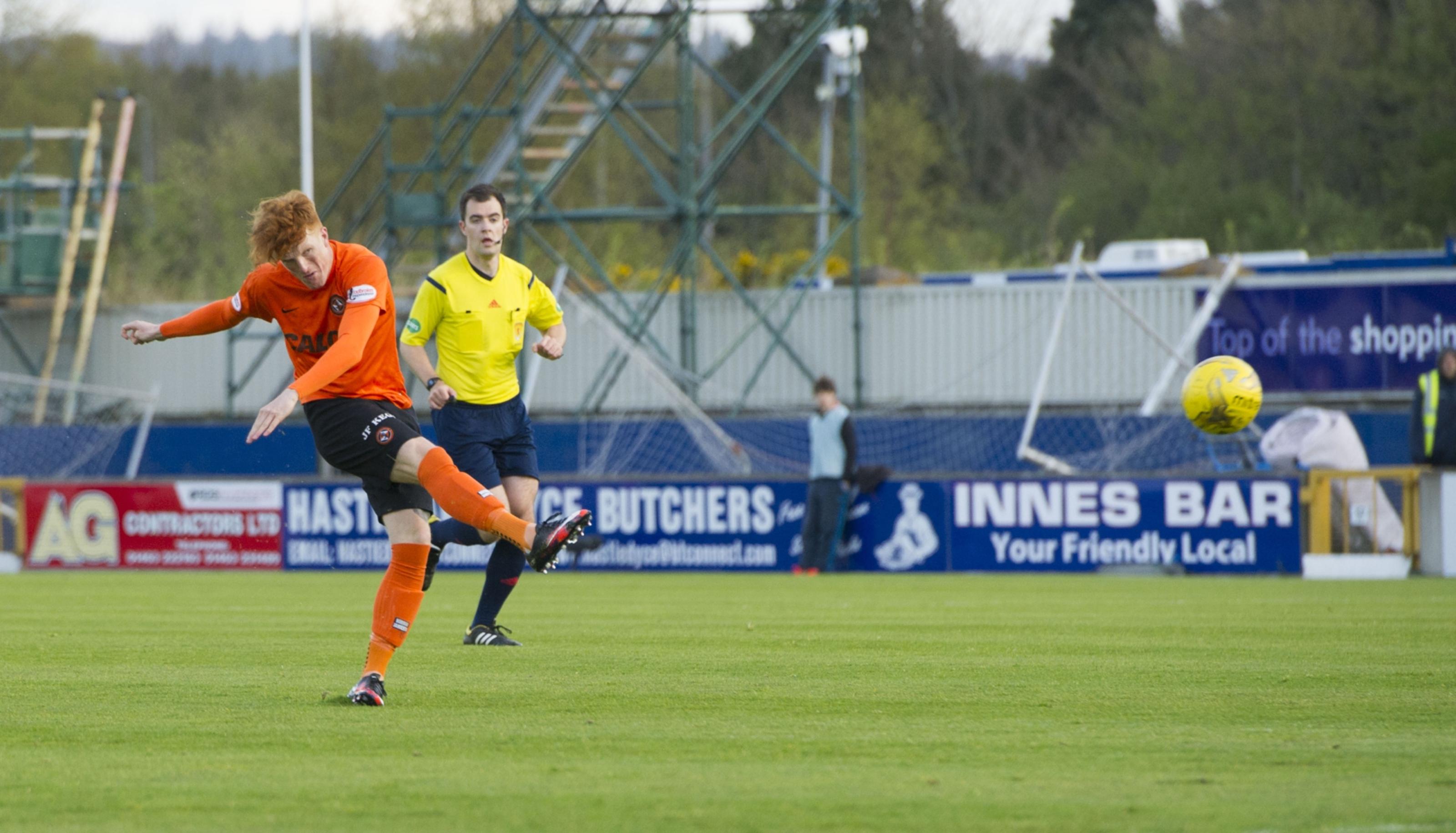 Simon Murray opens the scoring for United.