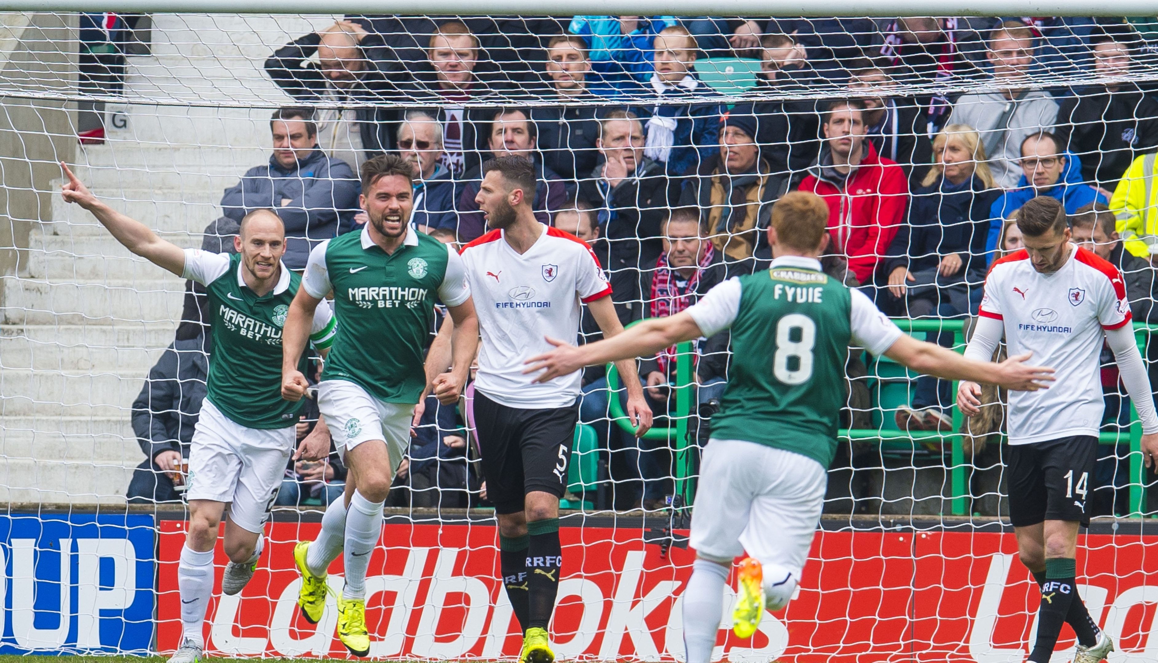 Hibs players celebrate their second goal.
