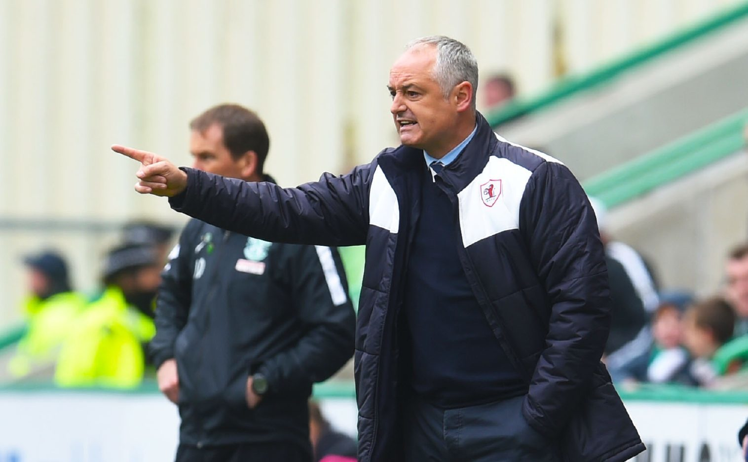 Ray McKinnon sends instructions to the Raith players at Easter Road.