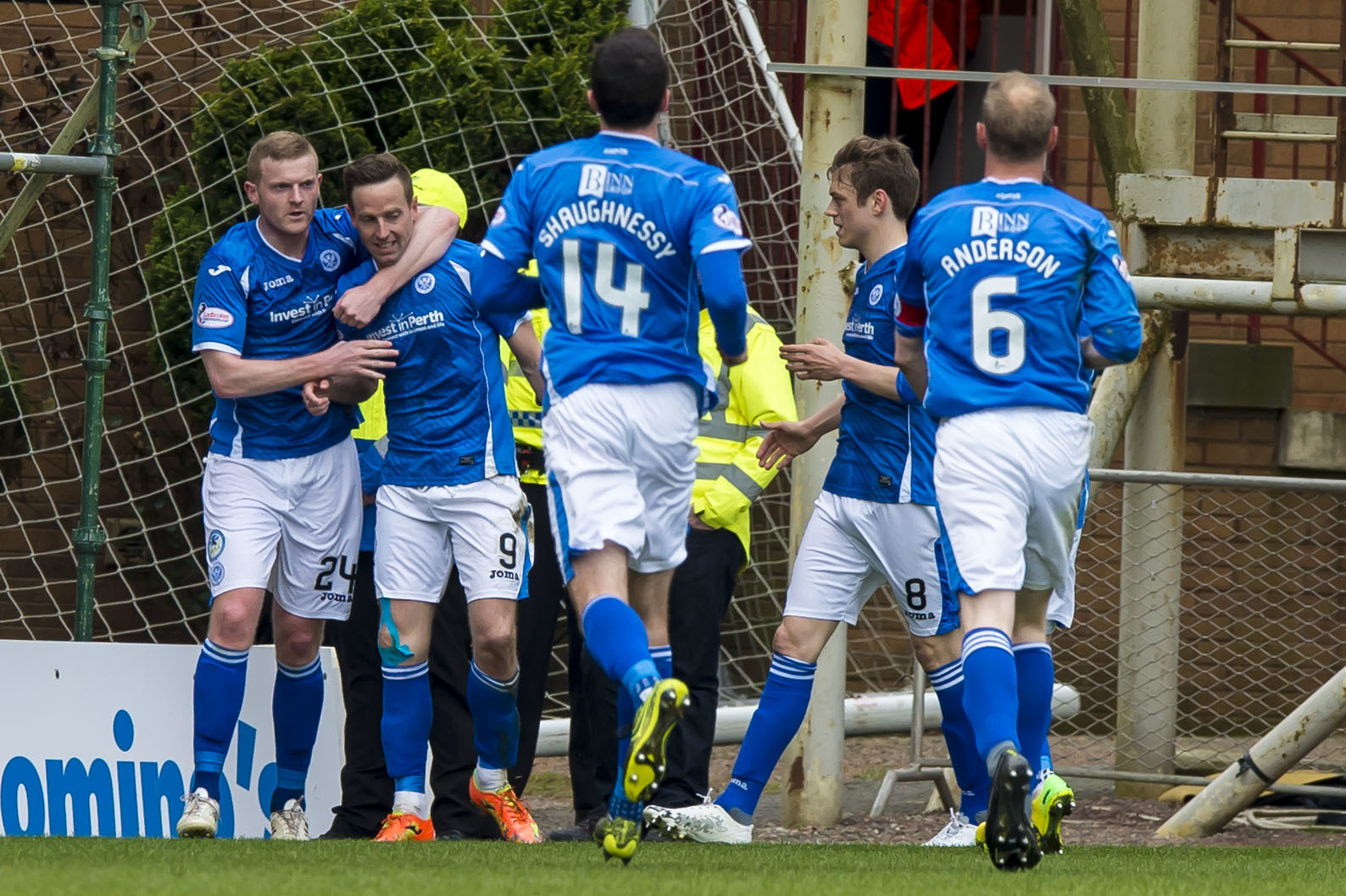 Steven MacLean (2nd left) celebrates with his team mates.