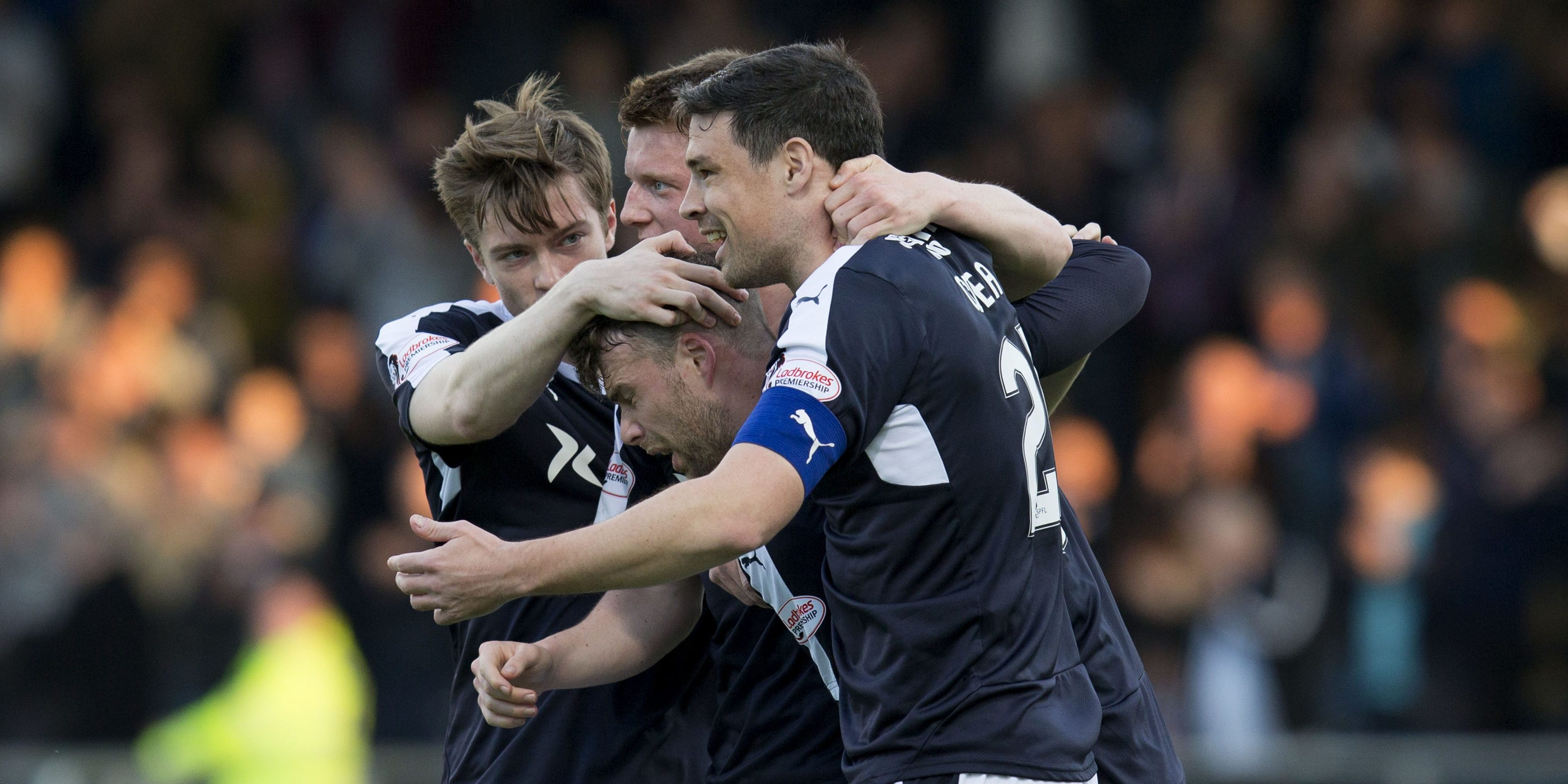 The Dundee players celebrate Rory Loys goal.