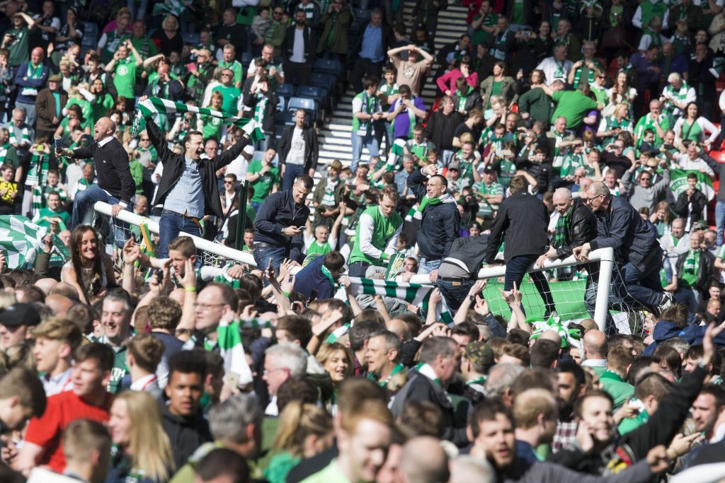 Fans invade the pitch after the William Hill Scottish Cup Final, at Hampden Park, Glasgow. PRESS ASSOCIATION Photo. Picture date: Saturday May 21, 2016. See PA story SOCCER Rangers. Photo credit should read: Jeff Holmes/PA Wire. EDITORIAL USE ONLY