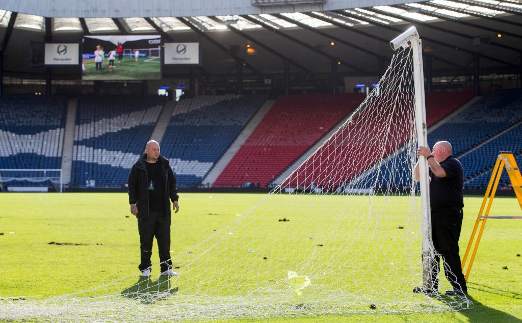Ground staff clean up after the pitch invasion at the end of the William Hill Scottish Cup Final, at Hampden Park, Glasgow. PRESS ASSOCIATION Photo. Picture date: Saturday May 21, 2016. See PA story SOCCER Scottish Final. Photo credit should read: Jeff Holmes/PA Wire. EDITORIAL USE ONLY