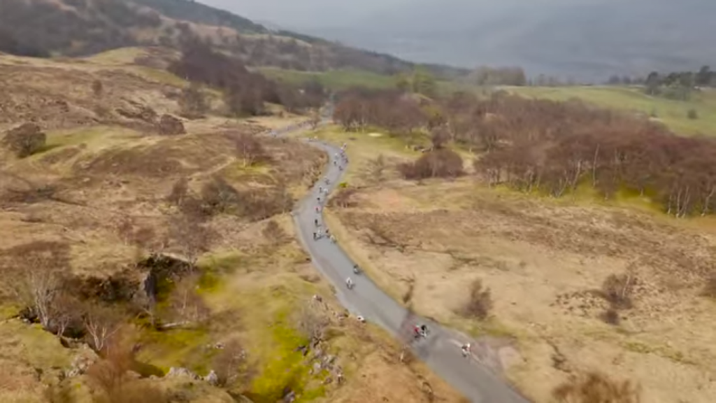 Riders crossing the shoulder of Schiehallion in the 2016 Etape Caledonia.