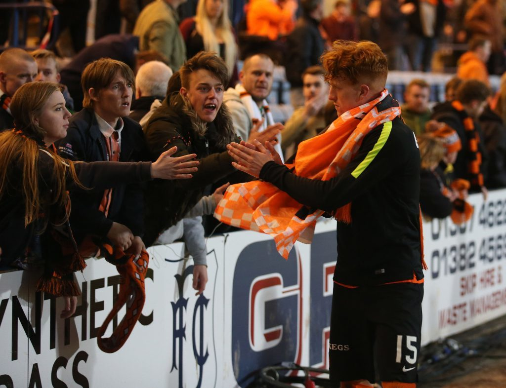 Dundee United's Simon Murray is consoled by fans after being relegated at the end of Mondays game against Dundee