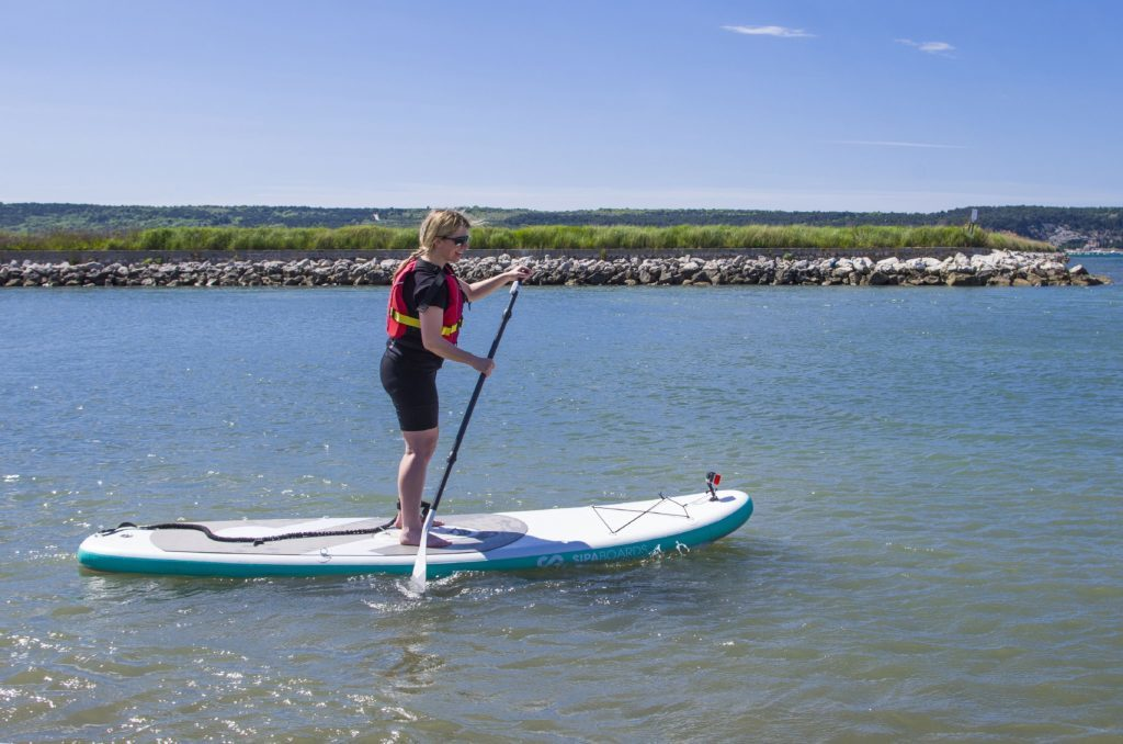 Abi Jackson getting to grips with her paddle board.