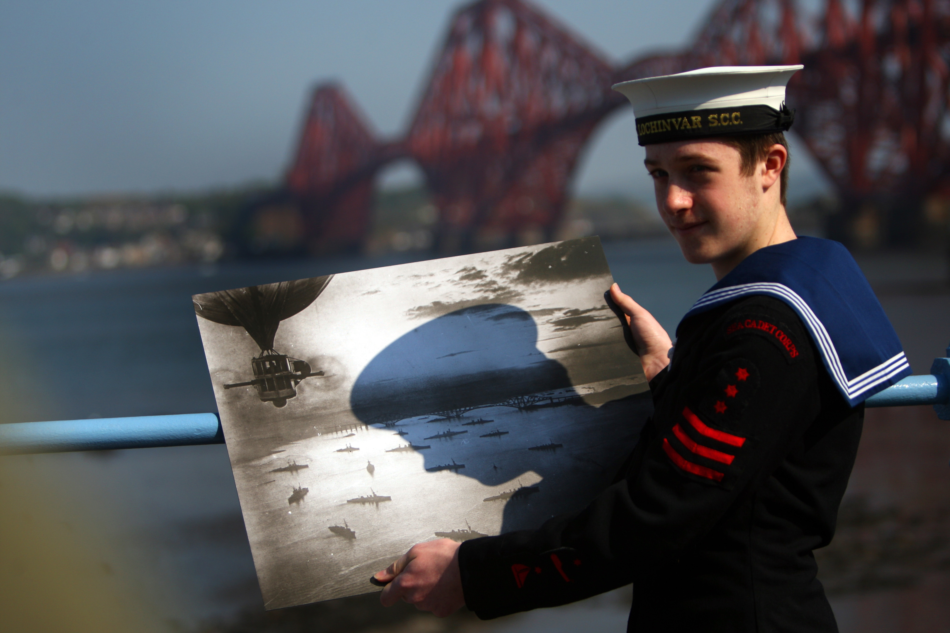 Sea Cadet Murray George with a photo of the fleet on the Forth in 1916.
