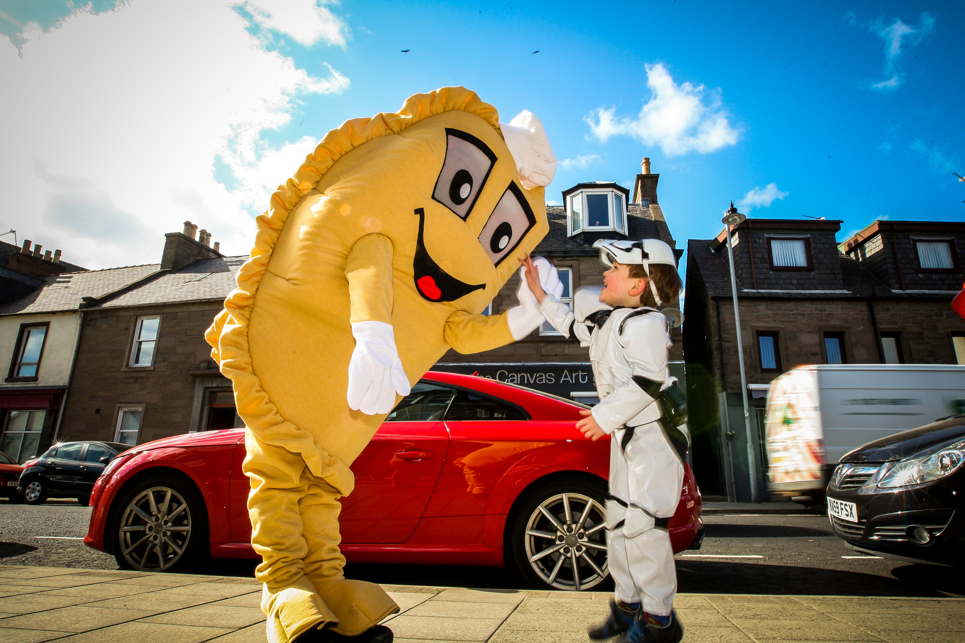 The Forfar Bridie gets a high five from storm trooper Jamie Duncan.