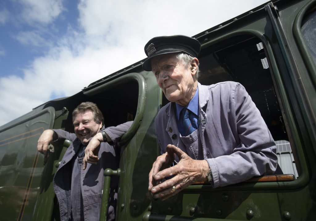Flying Scotsman driver Steve Chipperfield (left) and engine fireman Gordon Hodgson, 77, both from Carlisle, in the engine room, as they arrive at Tweedbank railway station.