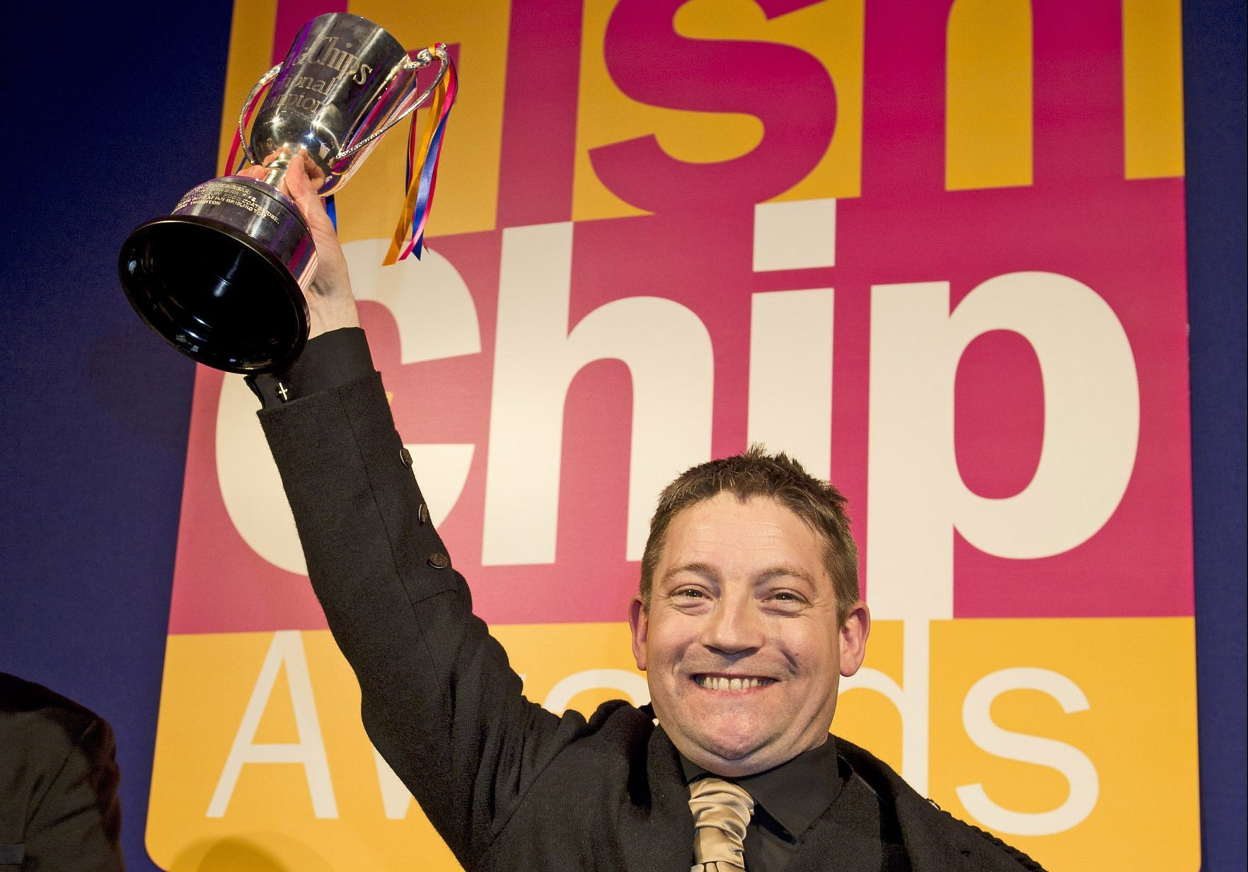 Calum Richardson picking up an trophy at the Independent Takeaway Fish and Chip Shop of the Year awards.