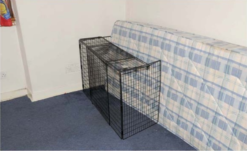 A cage found in the house.