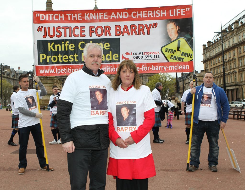 Dad Alan McLean and mum Tina McLean during a 'Justice for Barry' march in Glasgow