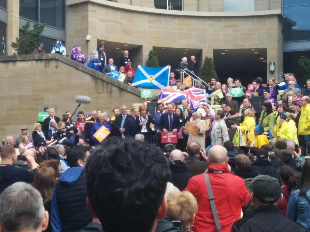 Alistair McConnachie waves his Union Flag at Nicola Sturgeon before being escorted away by police