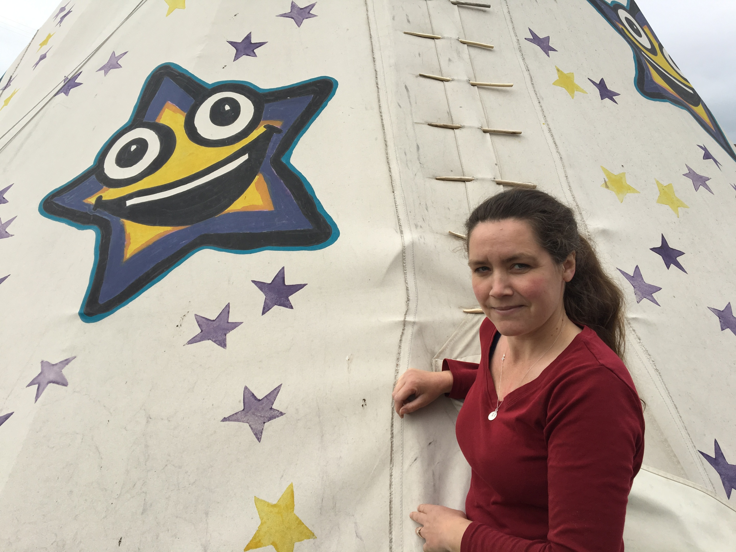 Karen Morrison, the founder of STAR, next to the wigwam where children can play and get stories