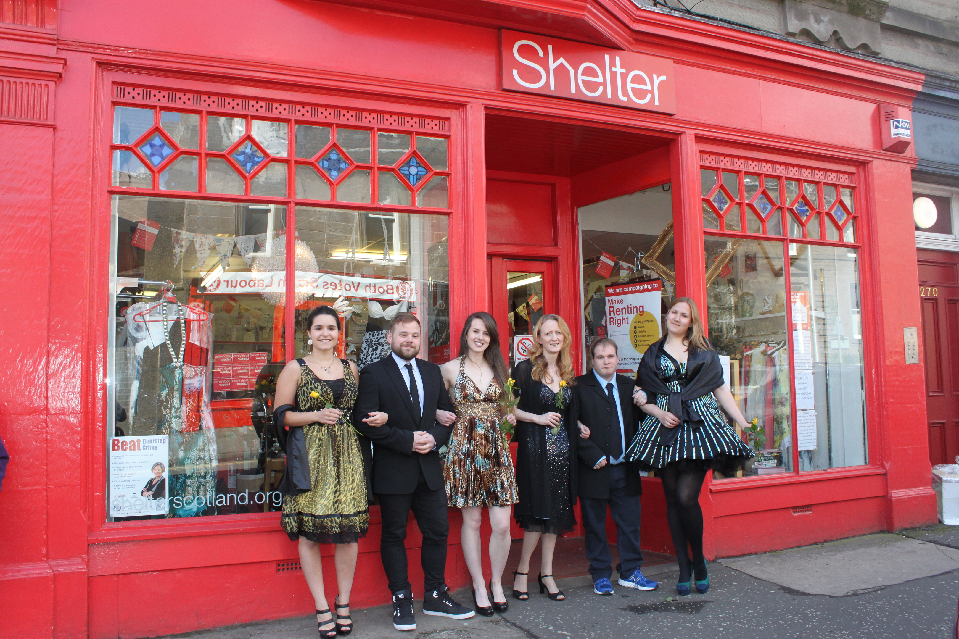 Some of the dresses on offer are modelled outside the Perth Road store.