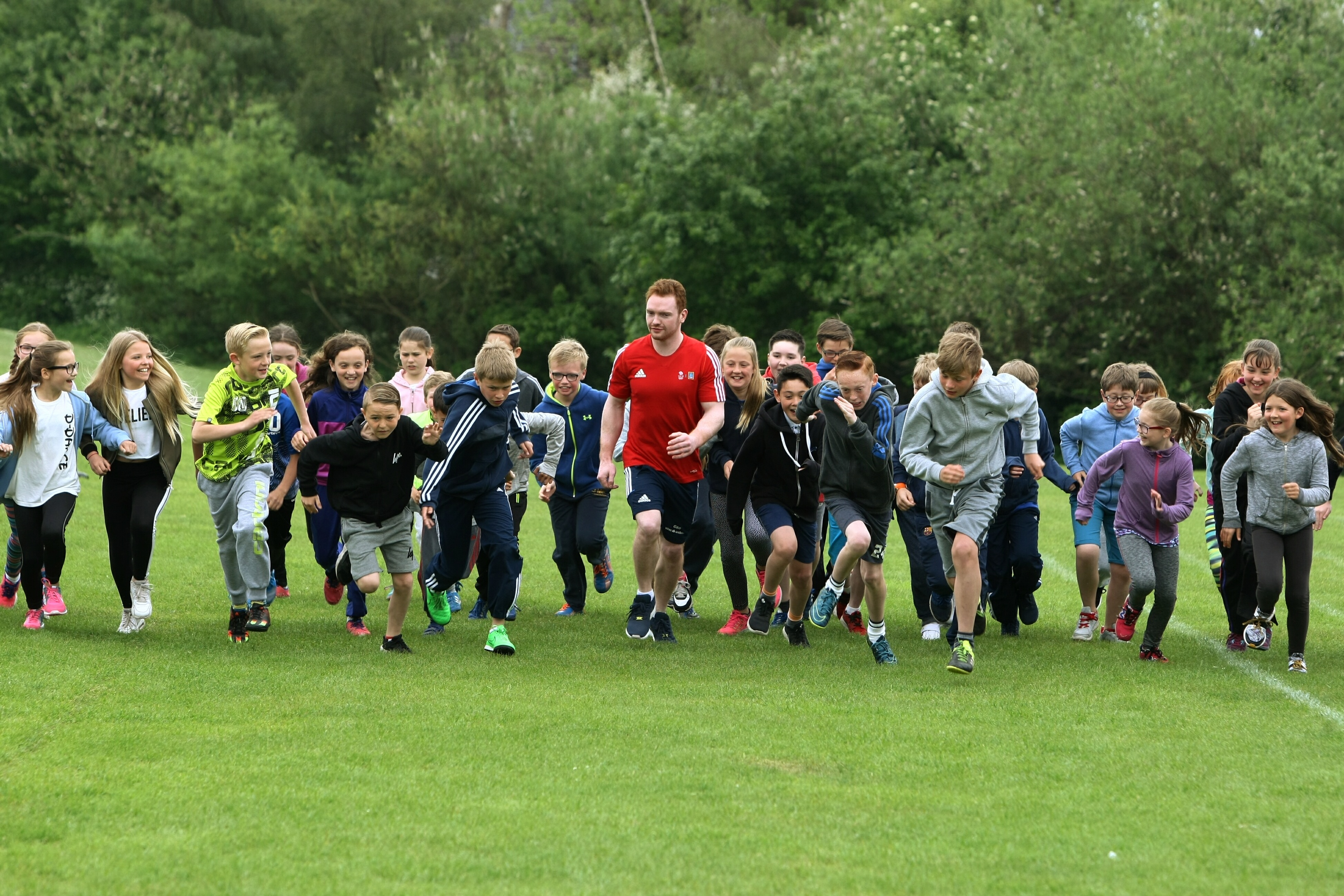 Team GB Gymnast, Dan Purvis (in the red shirt) taking part with the P6s on their daily mile