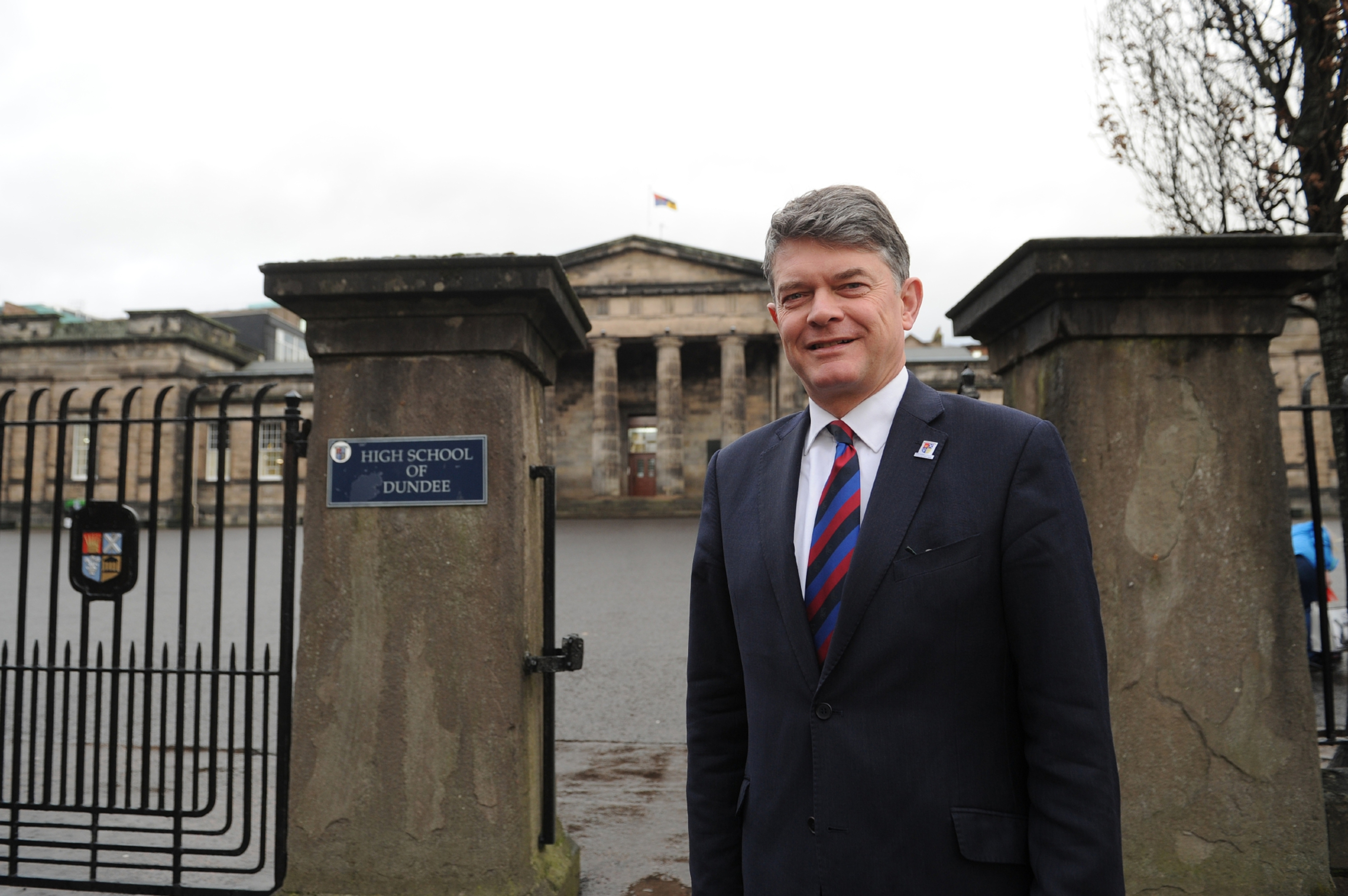 Dr John Halliday outside Dundee High School.