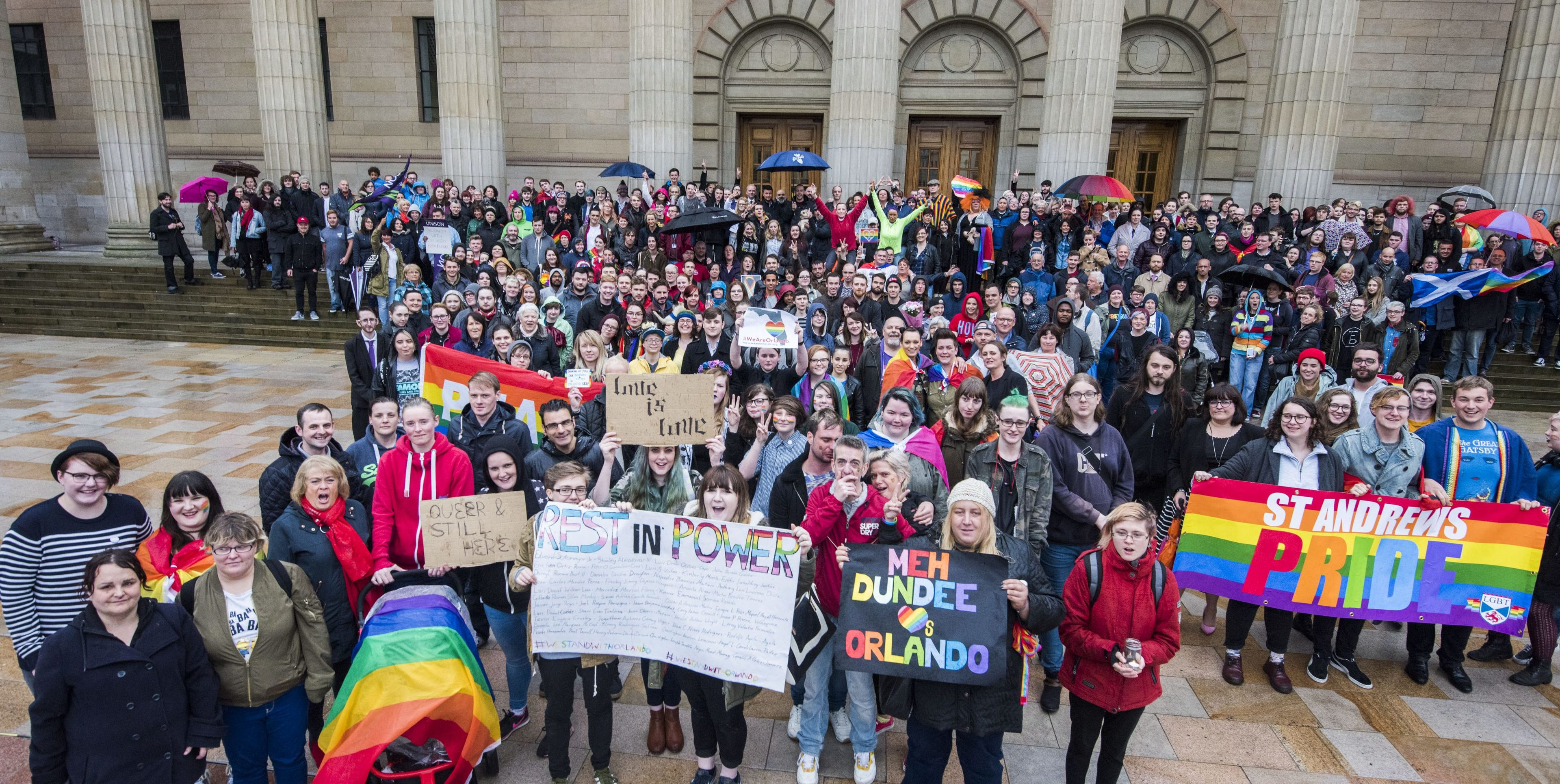 Around 300 stood in silence, lit candles and cast flowers into the fountains. Messages of support were also left at the top of the Caird Hall steps.