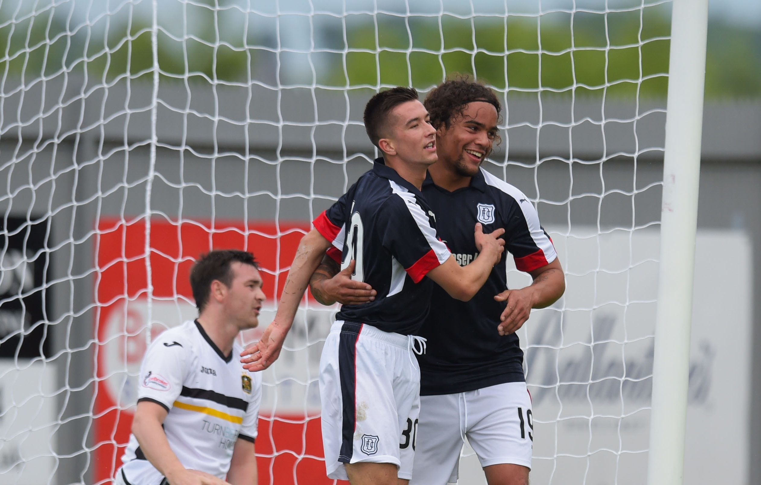 Dundee's Cammy Kerr celebrates with Yordi Teijsse after he scores his side's opener.