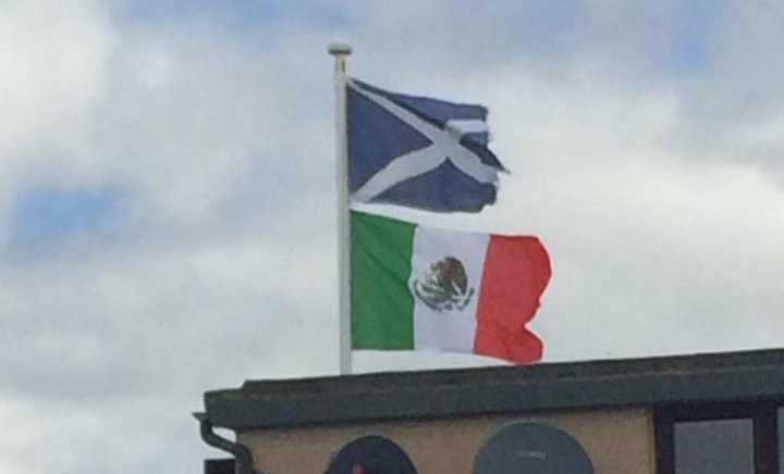 Mr Milne is flying the flag near to Trump's golf resort on the Menie Estate.