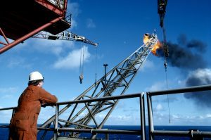 An oil rig worker on North Sea drilling platform.