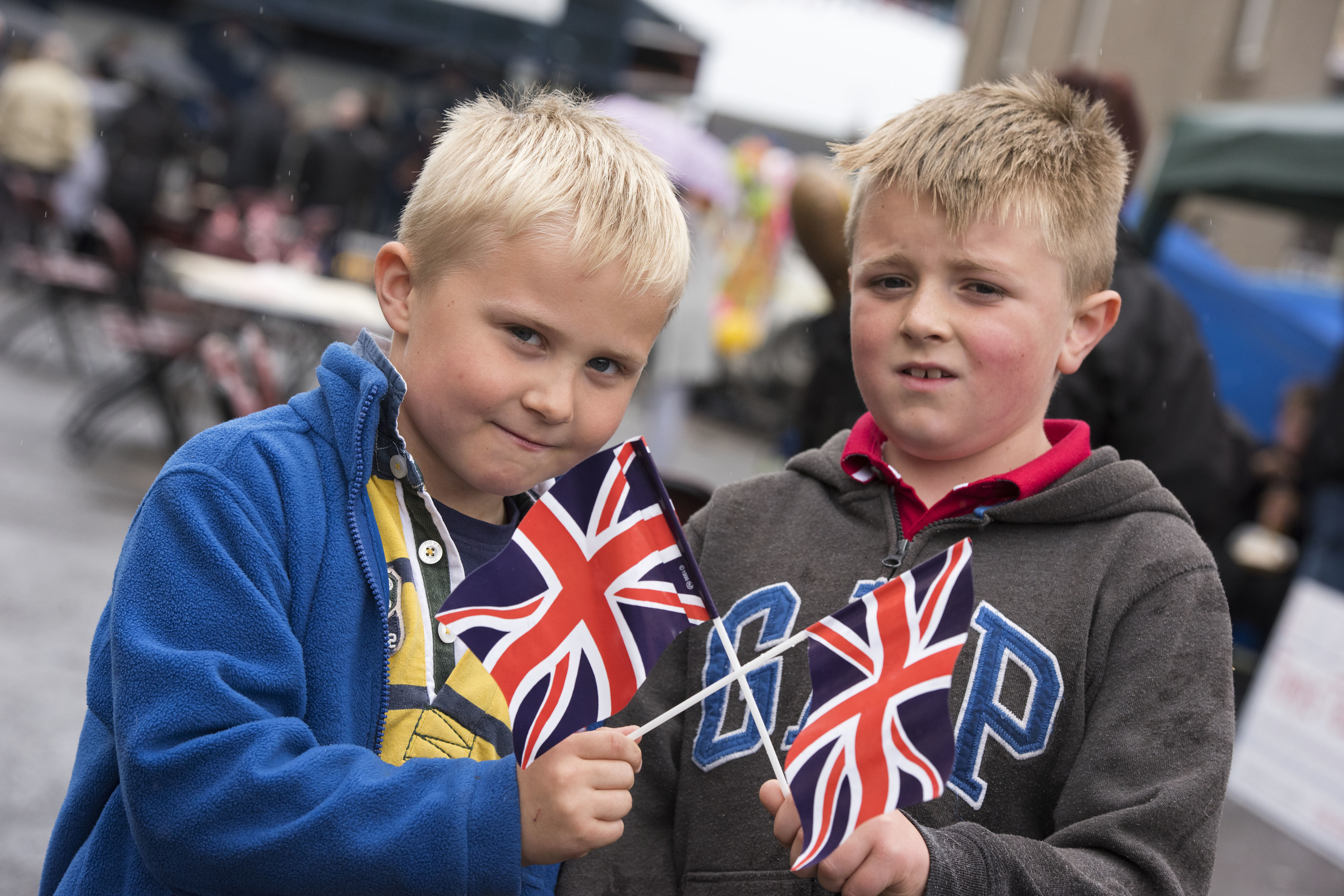 Harris McLeod and Connor Millen waving their Union Jacks at the Montrose street party.