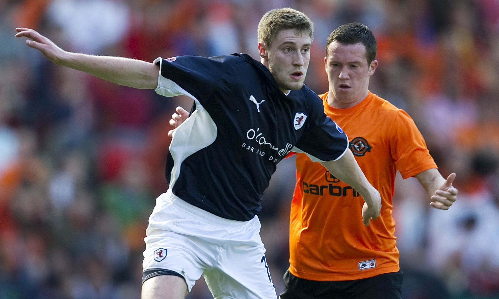Iain Williamson (left) holds off Danny Swanson in the 2010 Scottish Cup semi-final between Raith Rovers and Dundee United.