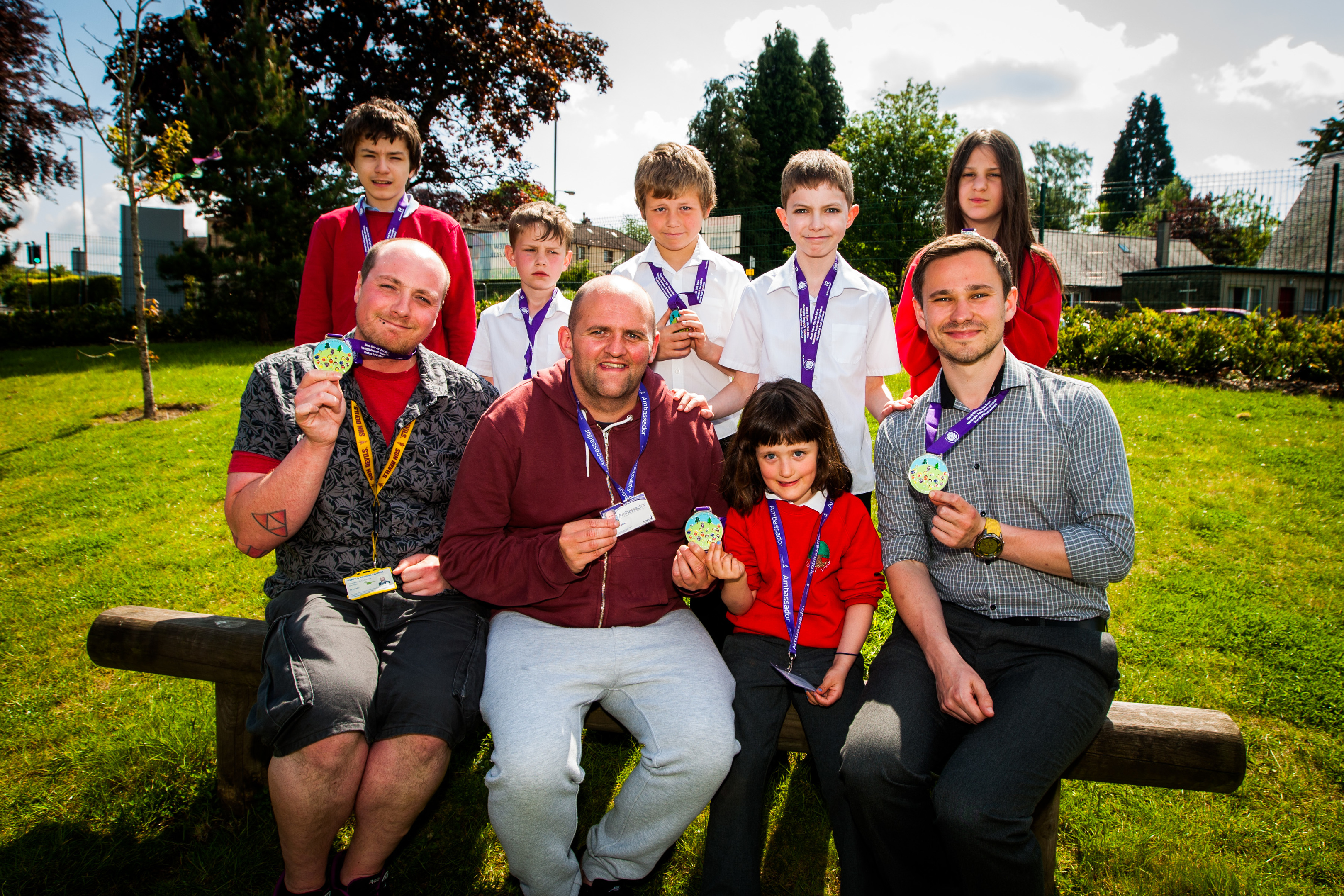 Alan Glynn presenting medals for the Alexis Rose Trail Race to pupils who designed the medal. He and his daughter Christina have already raised more than £100,000 for meningitis charities.