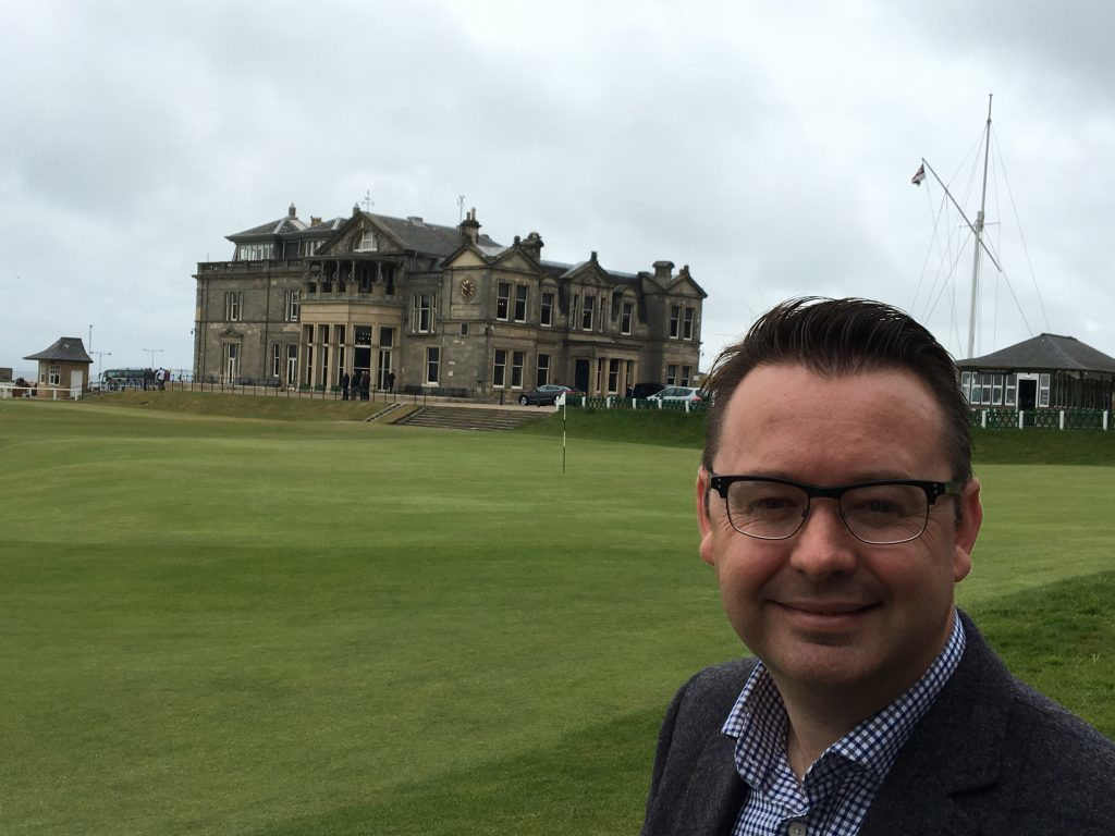 Author Roger McStravick next to the Old Course
