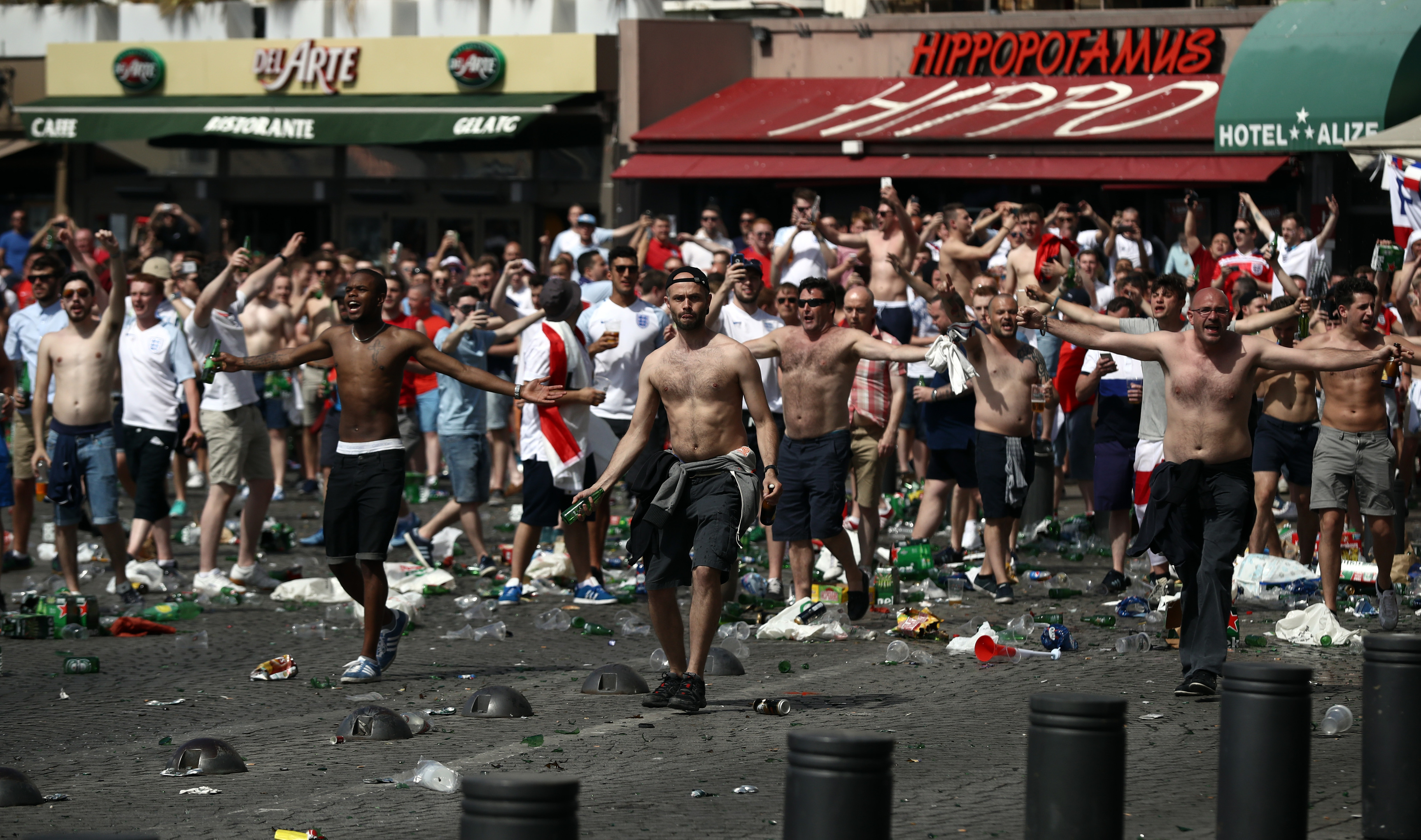 England fans throw bottles and clash with police ahead of the game against Russia on Saturday.