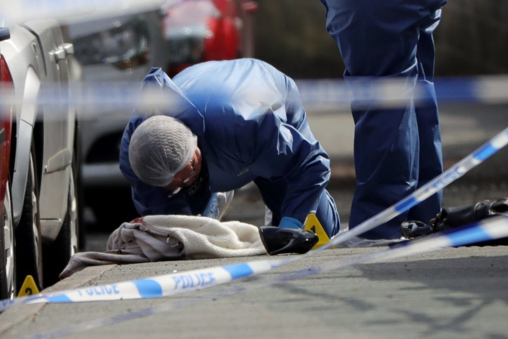 BIRSTALL, ENGLAND - JUNE 16: Forensic police examine clothing, shoes and a handbag at the scene after Jo Cox, 41, Labour MP for Batley and Spen, was shot and stabbed by an attacker at her constituicency on June 16, 2016 in Birstall, England. A man also suffered slight injuries during the attack. Jo Cox was reportedly shot and stabbed while holding her weekly surgery at Birstall Library, Birstall near Leeds and remains in a critical condition in hospital. A 52-year old man has been arrested in connection with the crime. (Photo by Christopher Furlong/Getty Images)