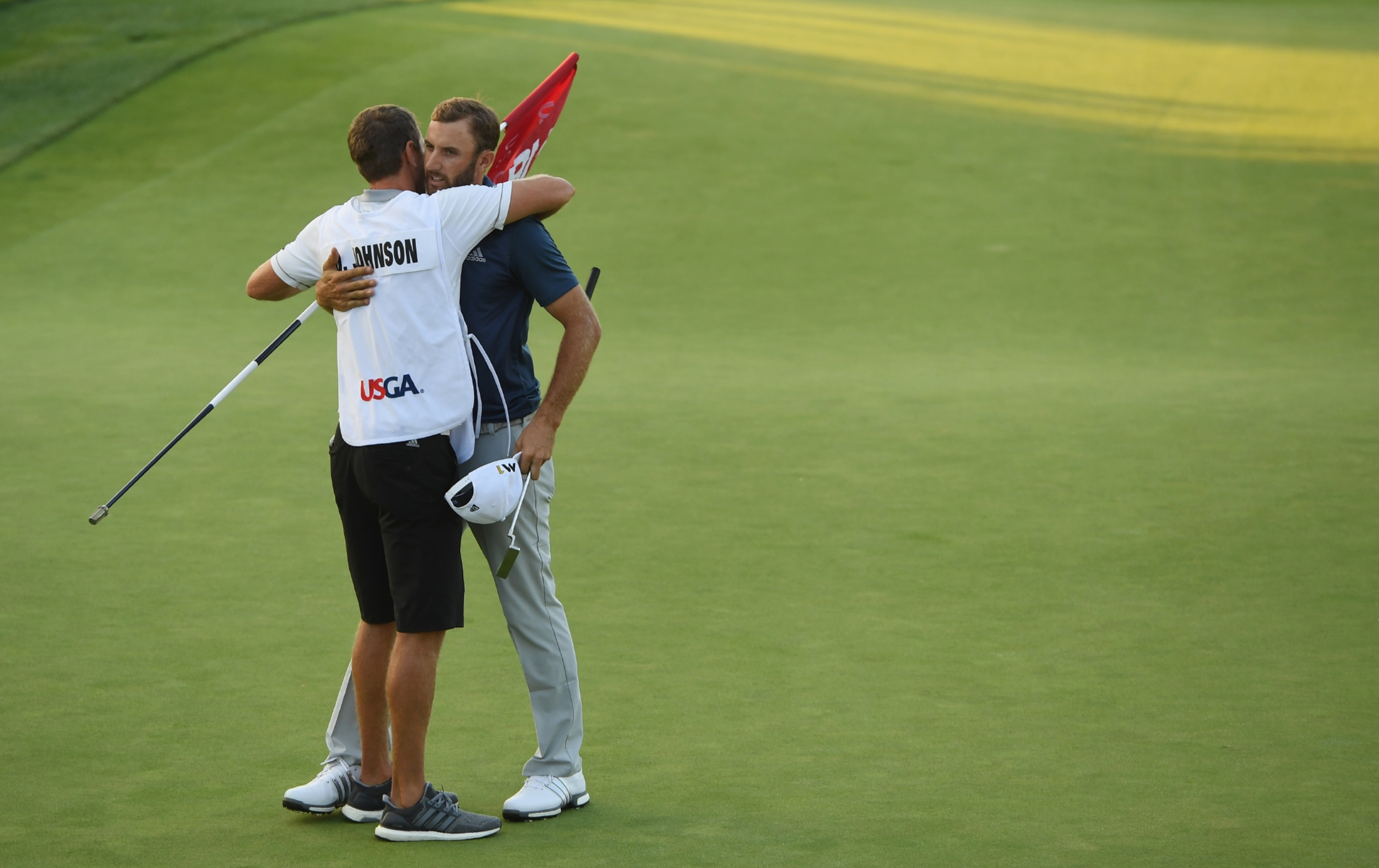 Dustin Johnson celebrates with brother and caddie Austin.