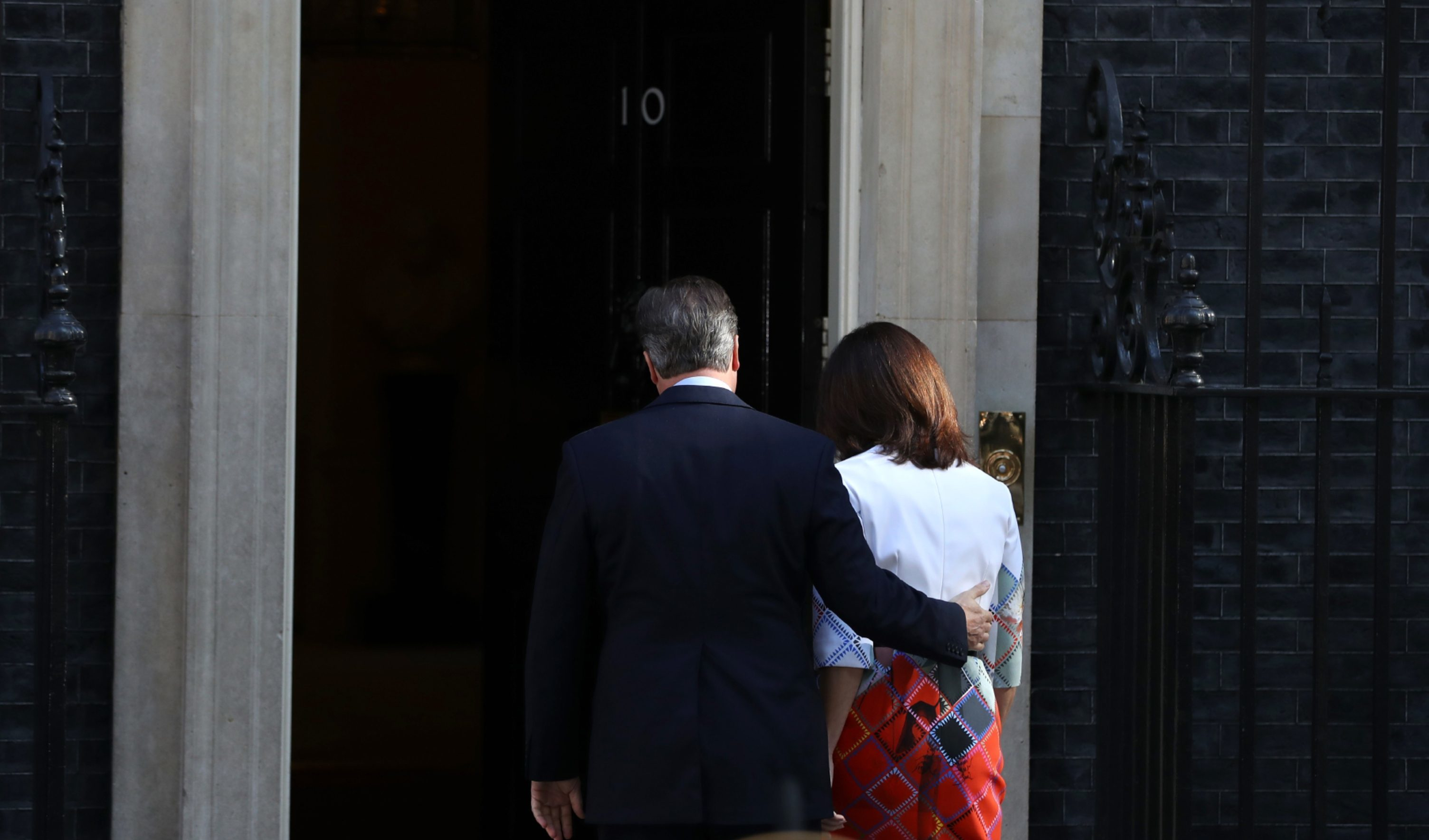David Cameron and wife Samantha head back into 10 Downing Street after he announced his intention to resign.