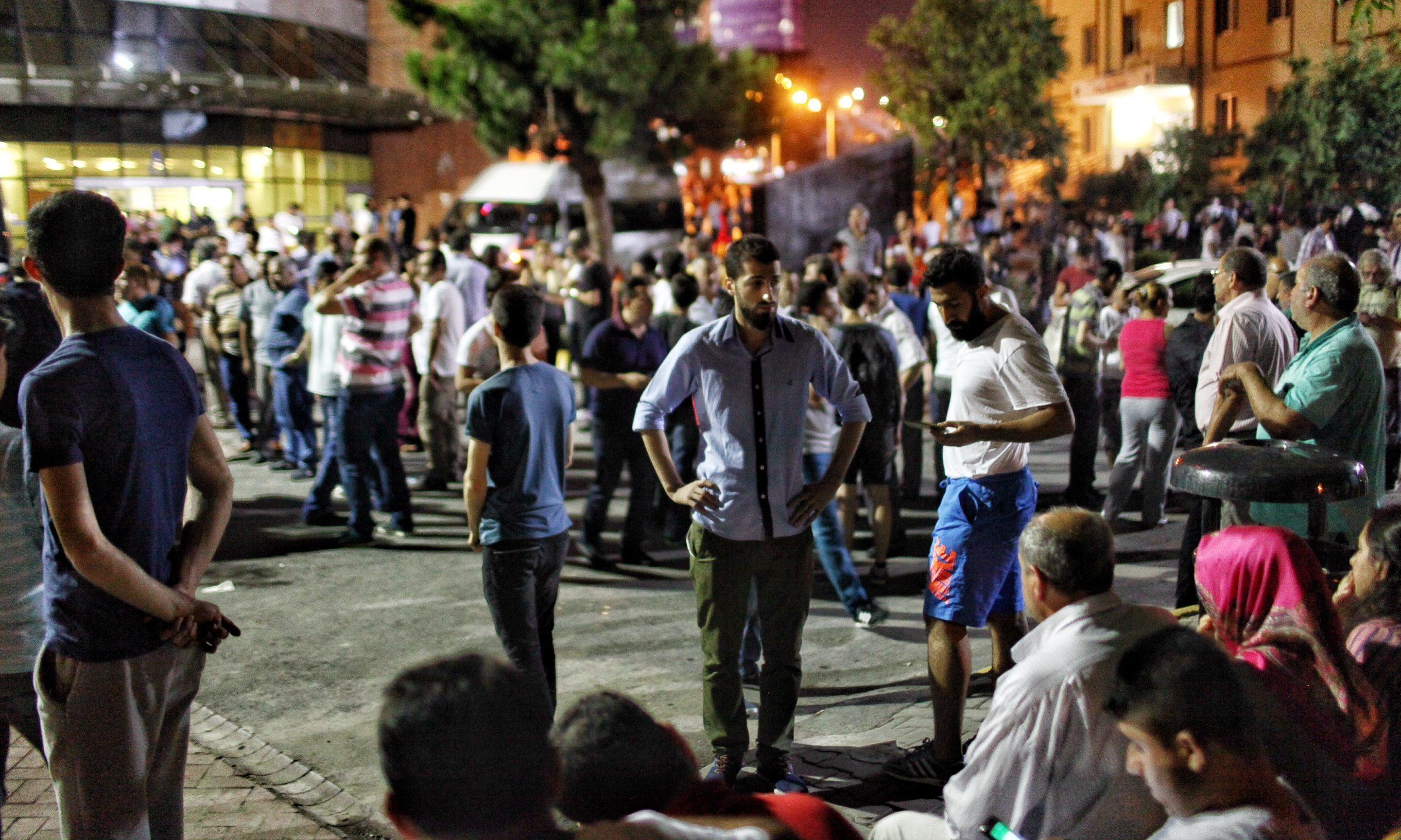 Relatives wait outside Bakirkoy Sadi Konuk Hospital in Istanbul after the airport attack.
