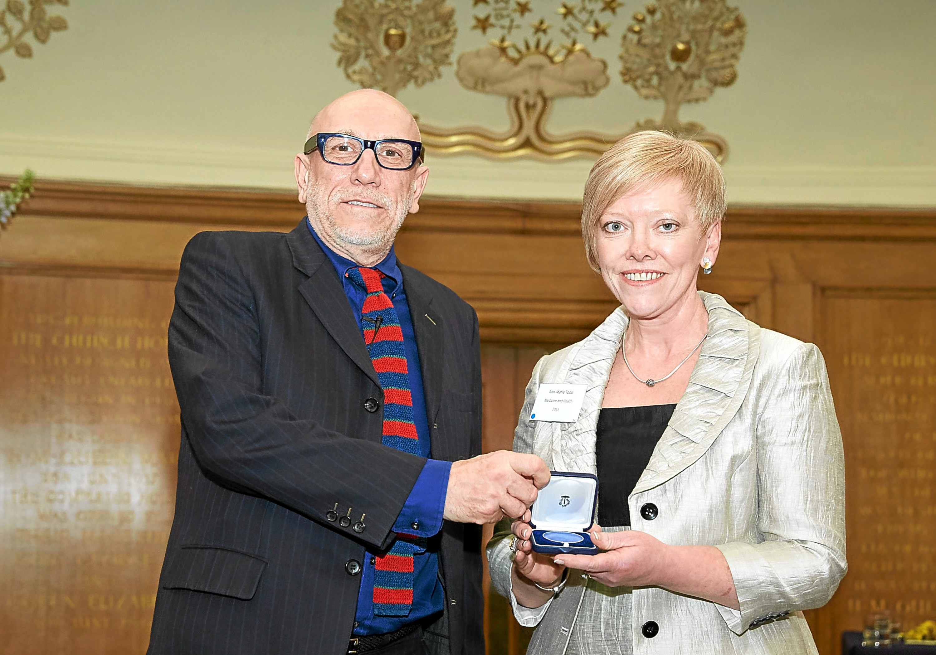 Dr Ann-Marie Todd was presented with a specially-designed Churchill medallion to mark the completion of her Fellowship. Dr Todd was awarded the Fellowship to research educational opportunities for carers and to review current practice within palliative medicine, both in community settings and hospitals.  The Winston Churchill Memorial Trust is the UKs national memorial to Sir Winston Churchill and each year the Trust awards Travelling Fellowship grants to UK citizens in a range of fields to enable them to carry out research projects overseas.   ©Clive Totman 2016 ALL RIGHTS RESERVED. It is the sole responsibility of the distributor/client/user/publisher to seek all permissions/releases BEFORE USE.  Moral rights asserted: Must credit / byline photographer