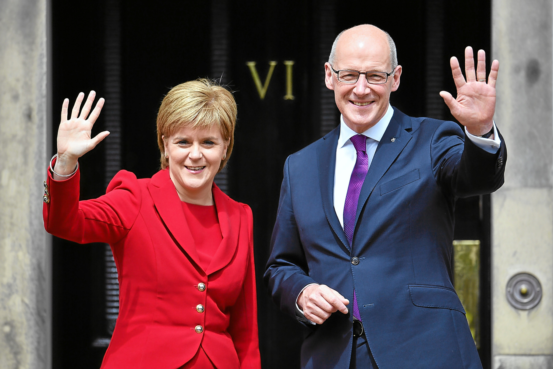 Nicola Sturgeon and John Swinney.