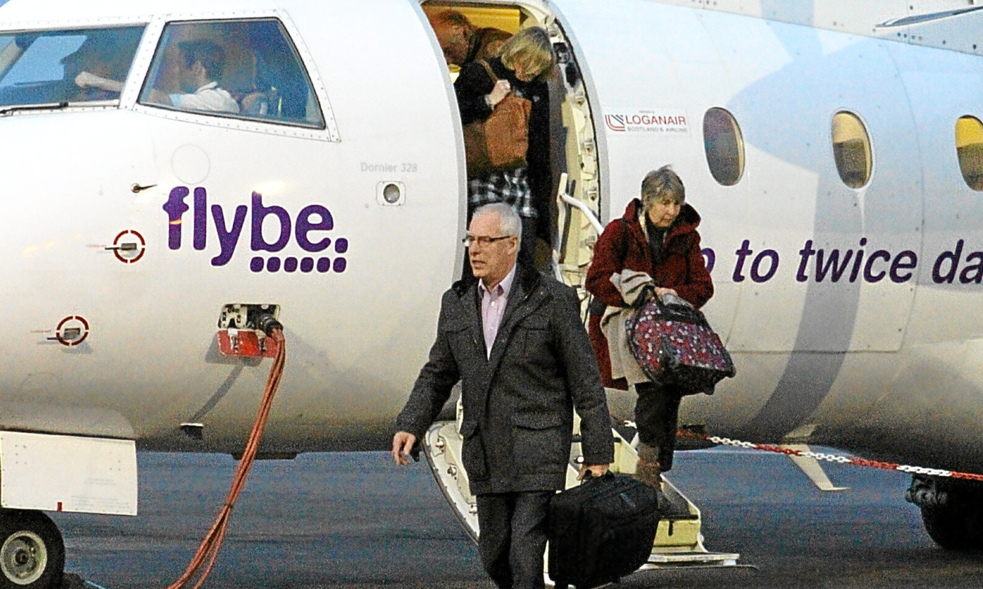 Passengers disembark from a Flybe flight at Dundee Airport