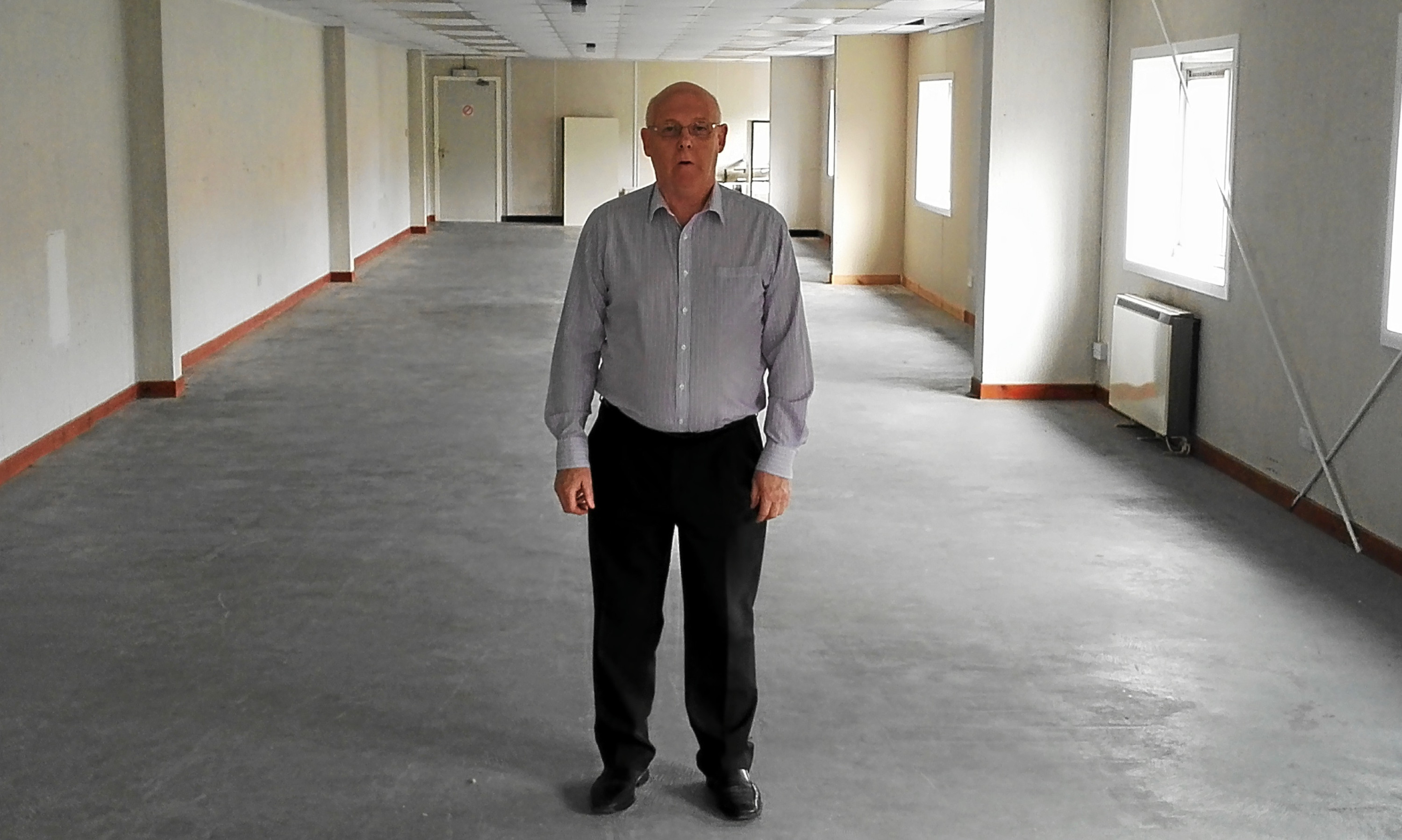 Businessman Jim Pickett in the vacant unit he is now paying rates on.