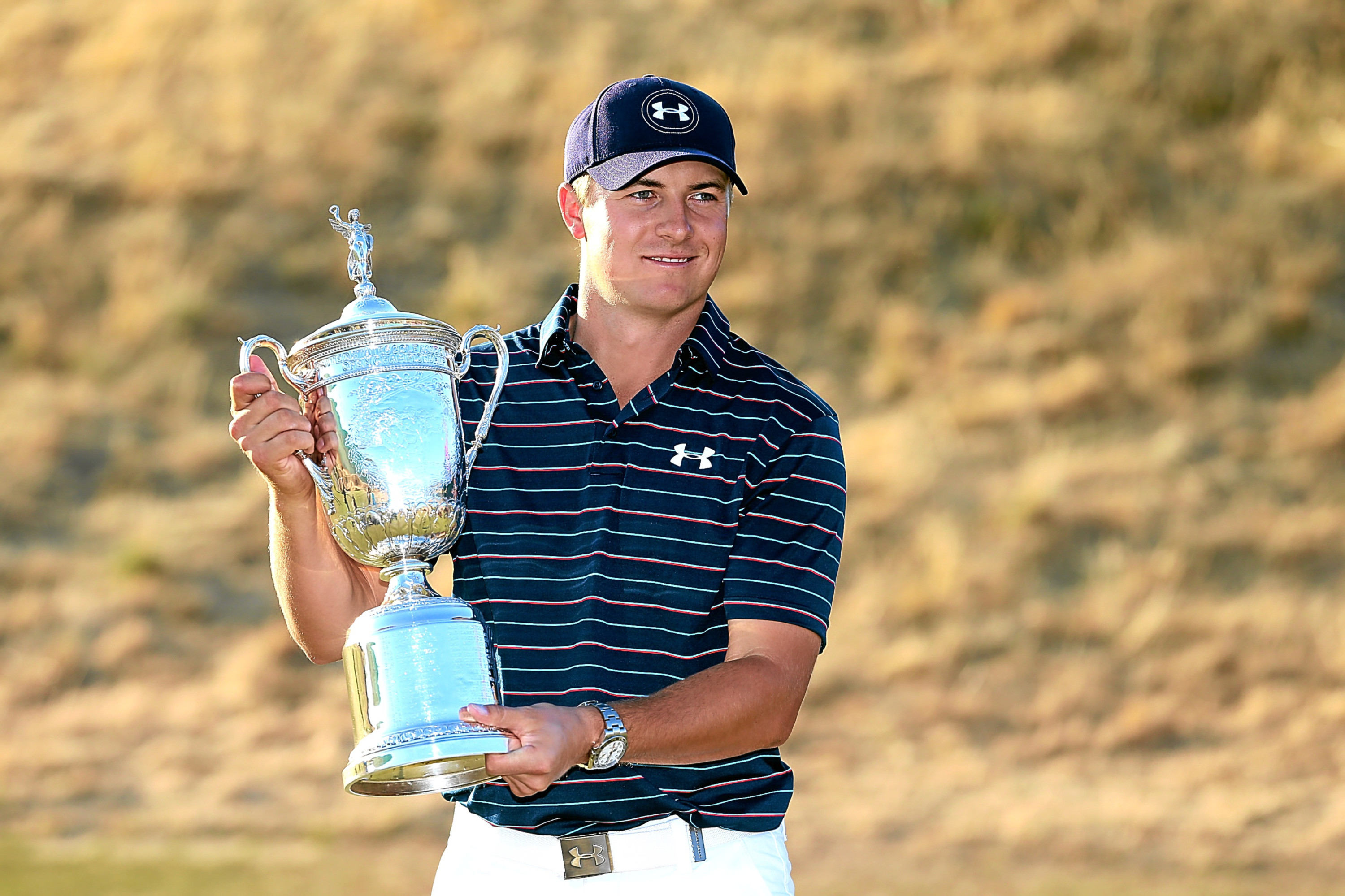 Jordan Spieth poses with the trophy after winning the 115th US Open Championship.