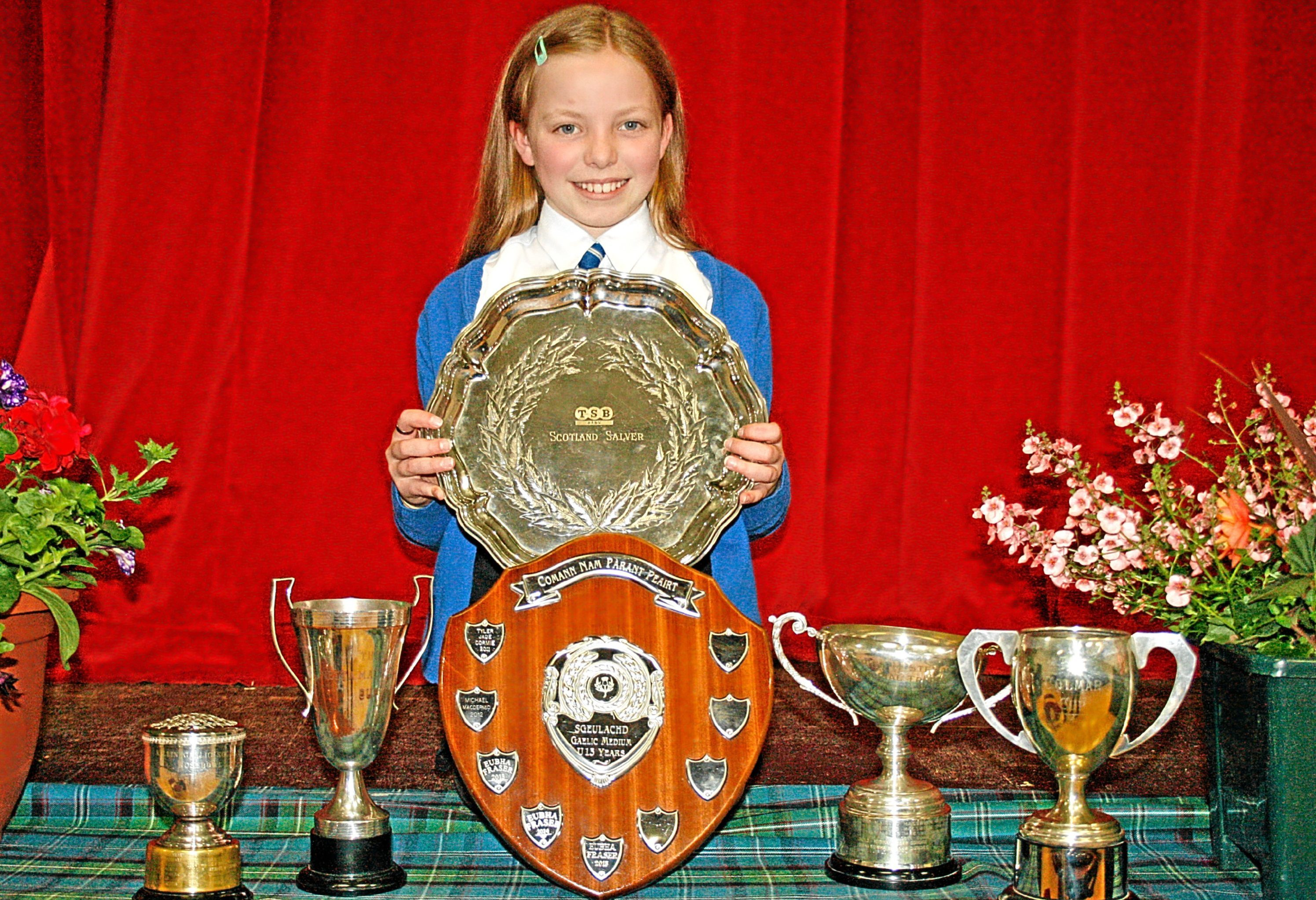 Eubha Fraser with her trophies.