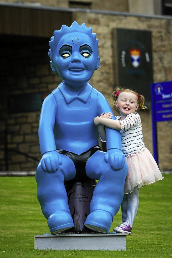 Three-year-old Lola enjoying the Dr Manhattan Wullie during the bucket trail. Chris van der Kuly has ensured the statue will now be returning to his old university.