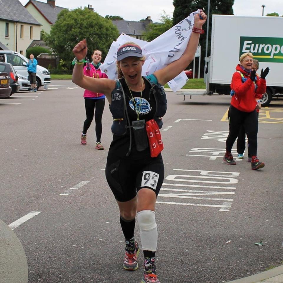 Triumphant Angie crosses the Fort William finish line