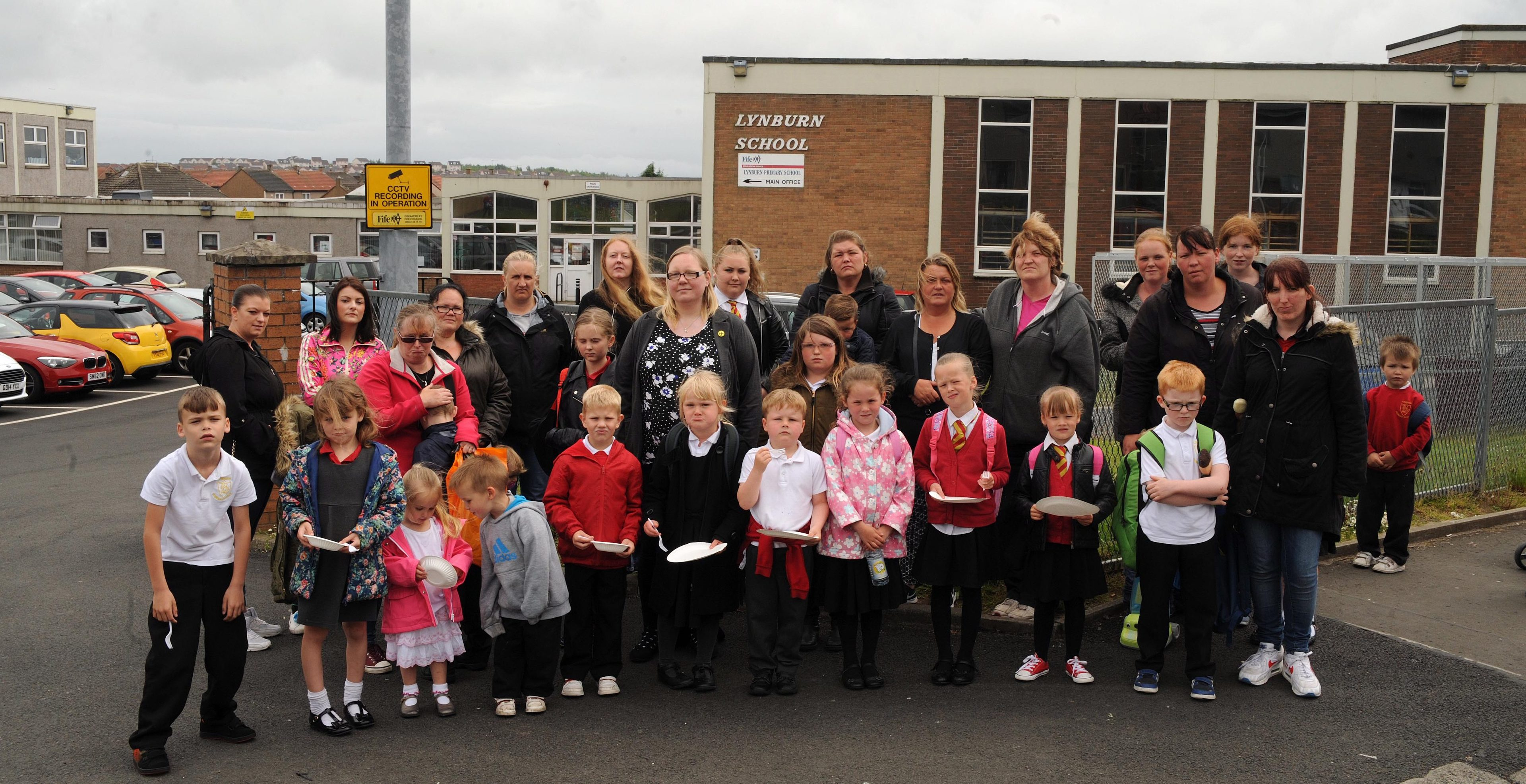 Pupils at parents join Councillor Fay Sinclair outside Lynburn primary.