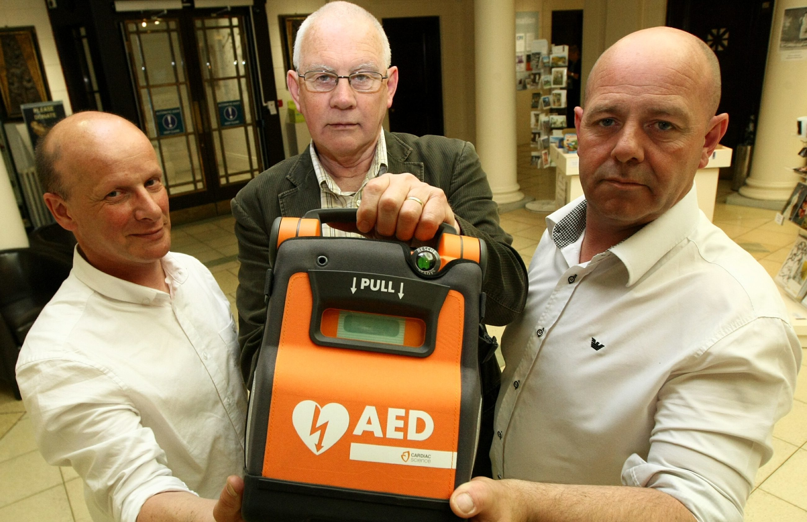 Perth and Kinross Council unveiled the plans for publically available defibrillators at a demonstration event at Perth Museum.  Picture shows left, Alan Stewart, first aid adviser, and right, Alan Moffat, first aid trainer with Bob Ellis - vice convenor of health, safety and wellbeing team.