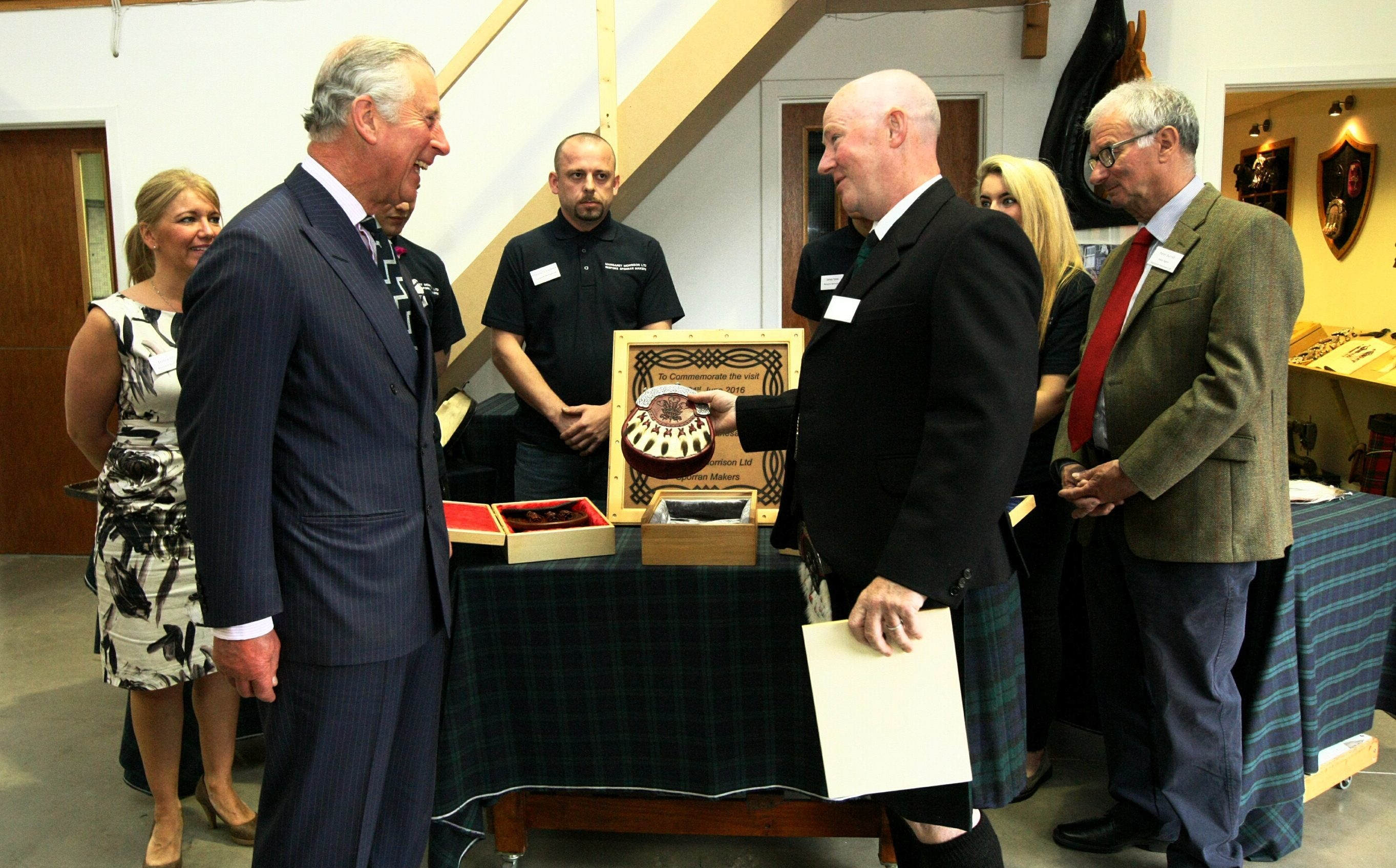Director Greg Whyte presenting Prince Charles with sporrans.