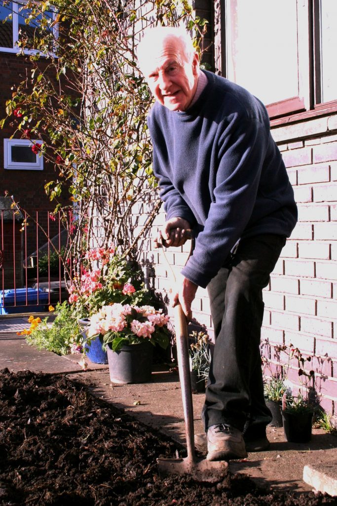 Digging compost into borders