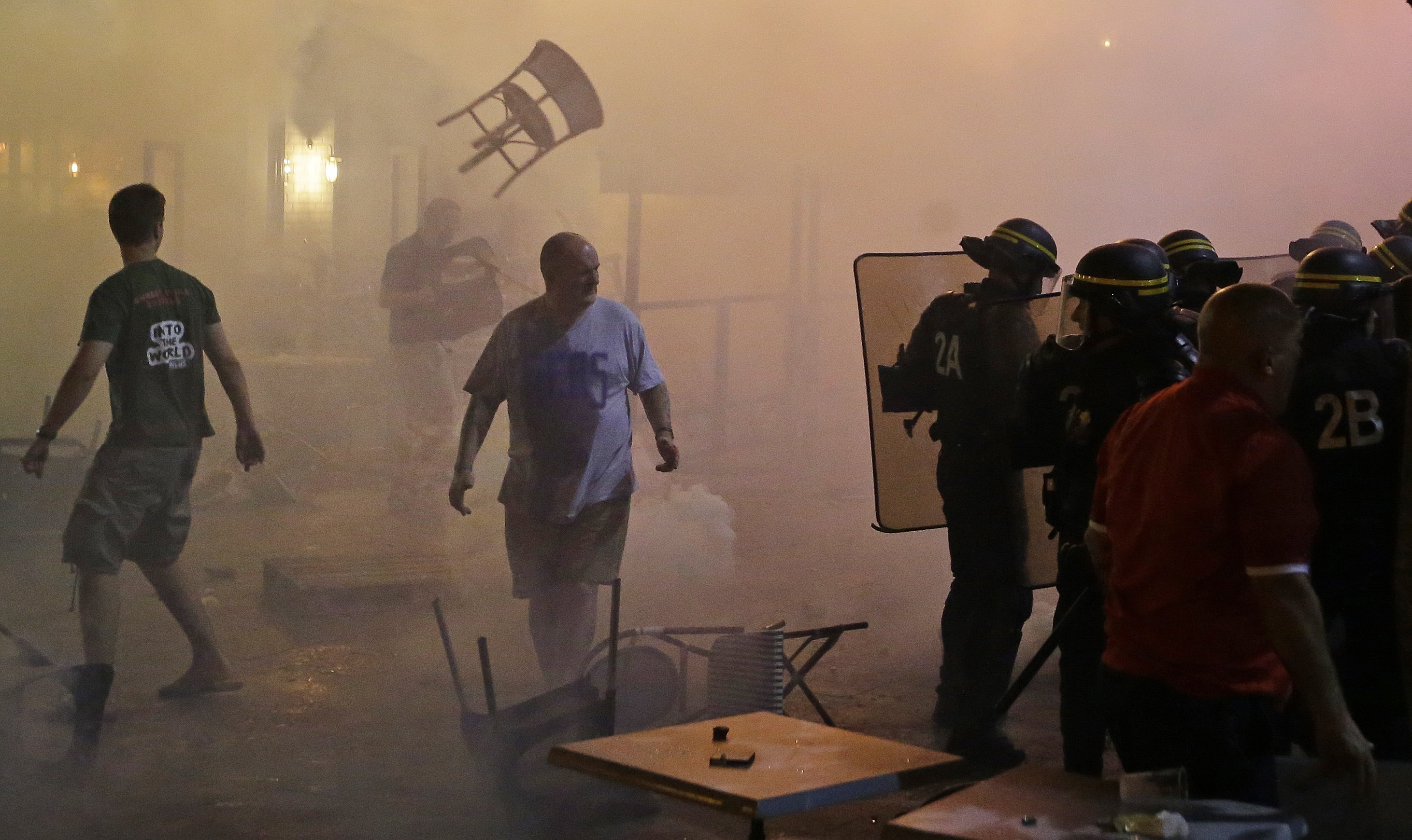 A chair flies through the air during clashes between police and England supporters in downtown Marseille.