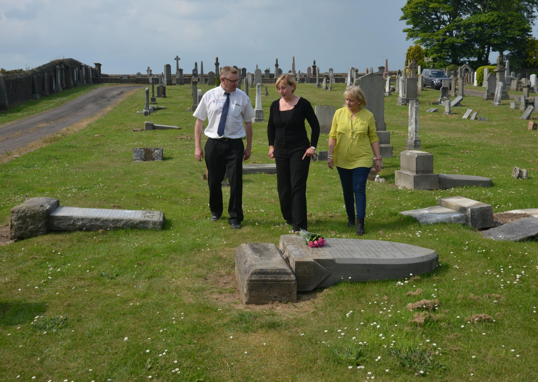 From left: Andrew Forgan, Liz Murphy and Karen Skene at Leslie Cemetery.