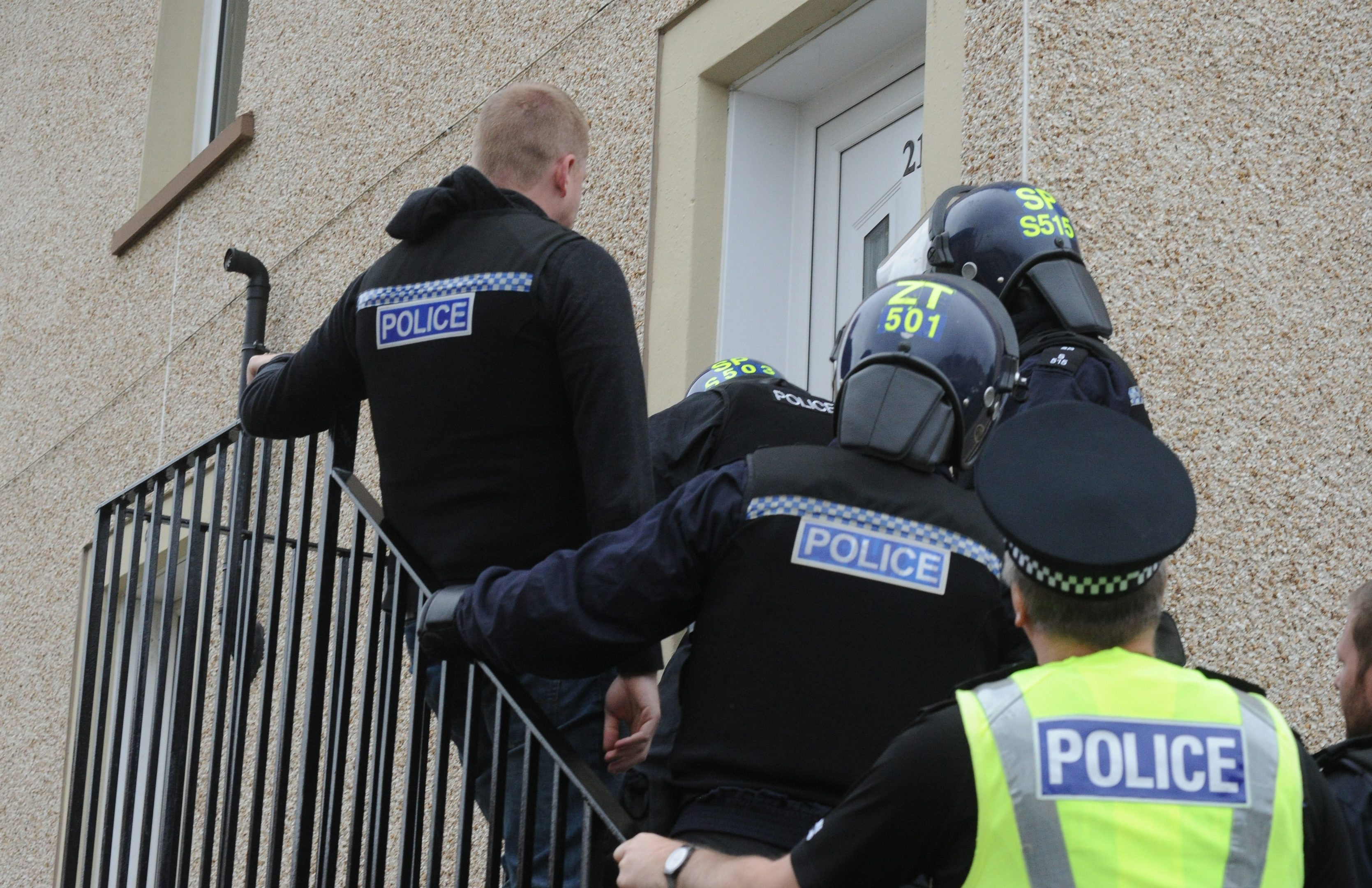 Police as they 'hit' four properties in Kirkcaldy in relation to crimes which have been reported during their investigation into the Darren Adie murder.